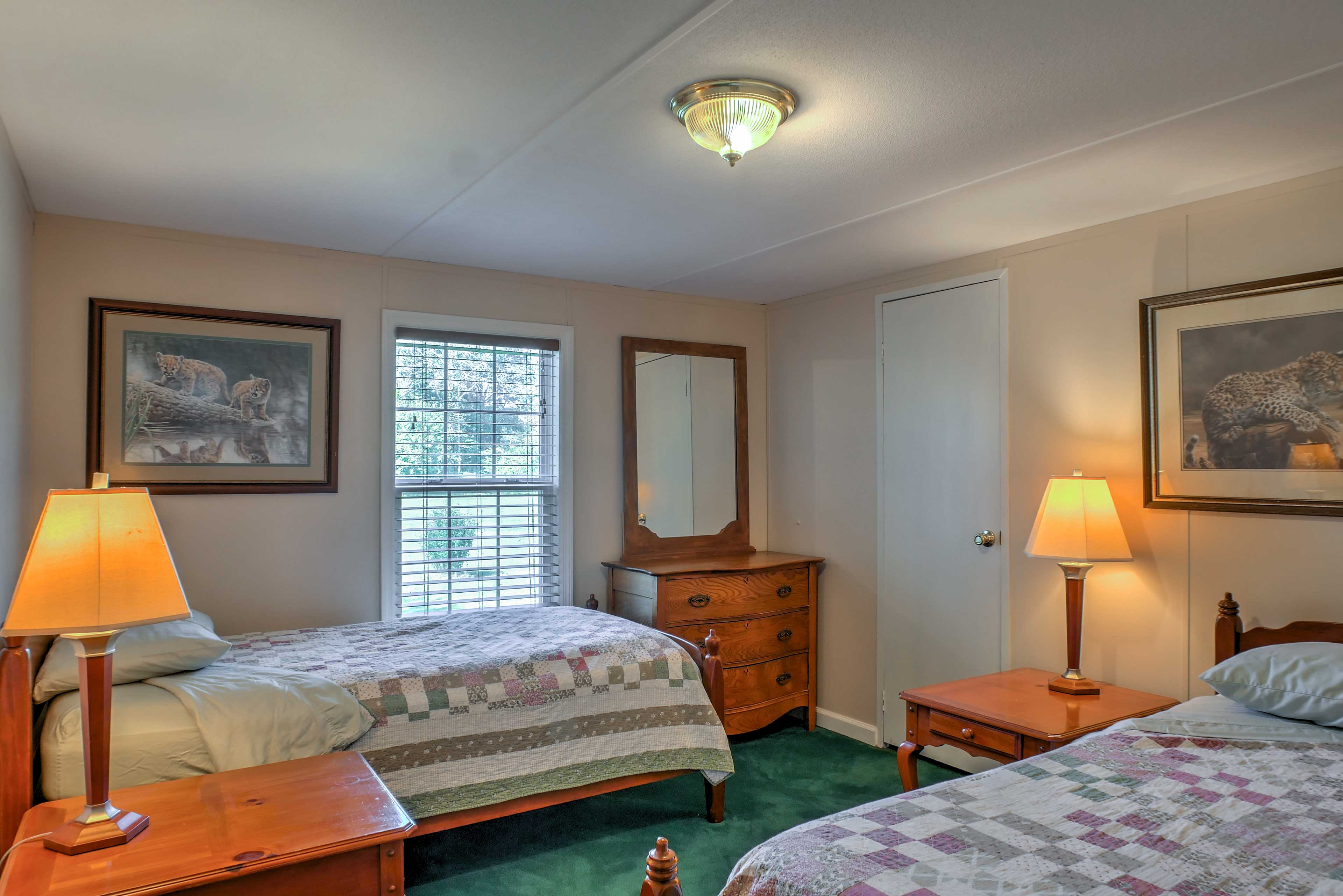 The third bedroom hosts 2 twin beds topped with colorful quilts.