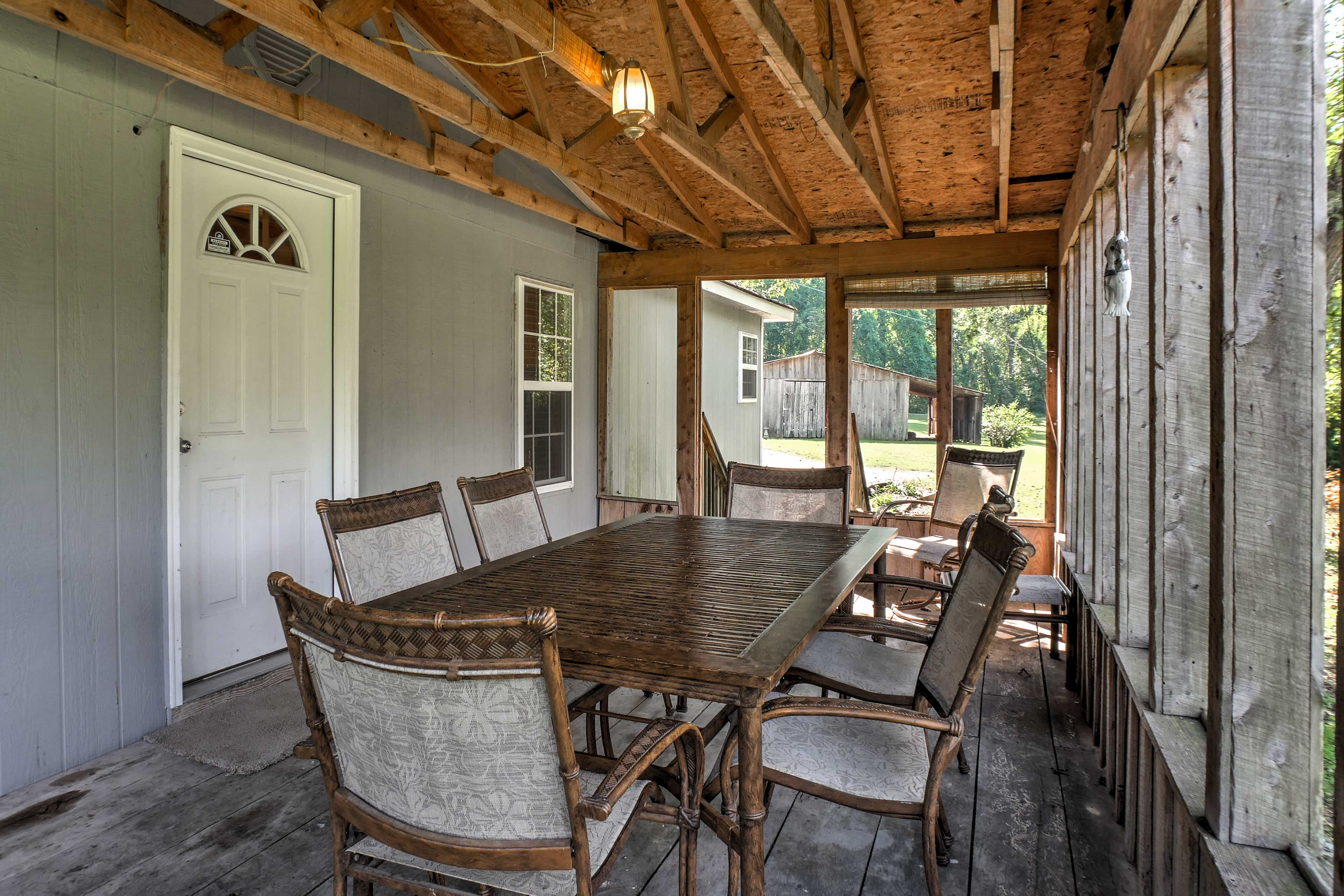 Dine outside in the screened-in comfort of the porch.