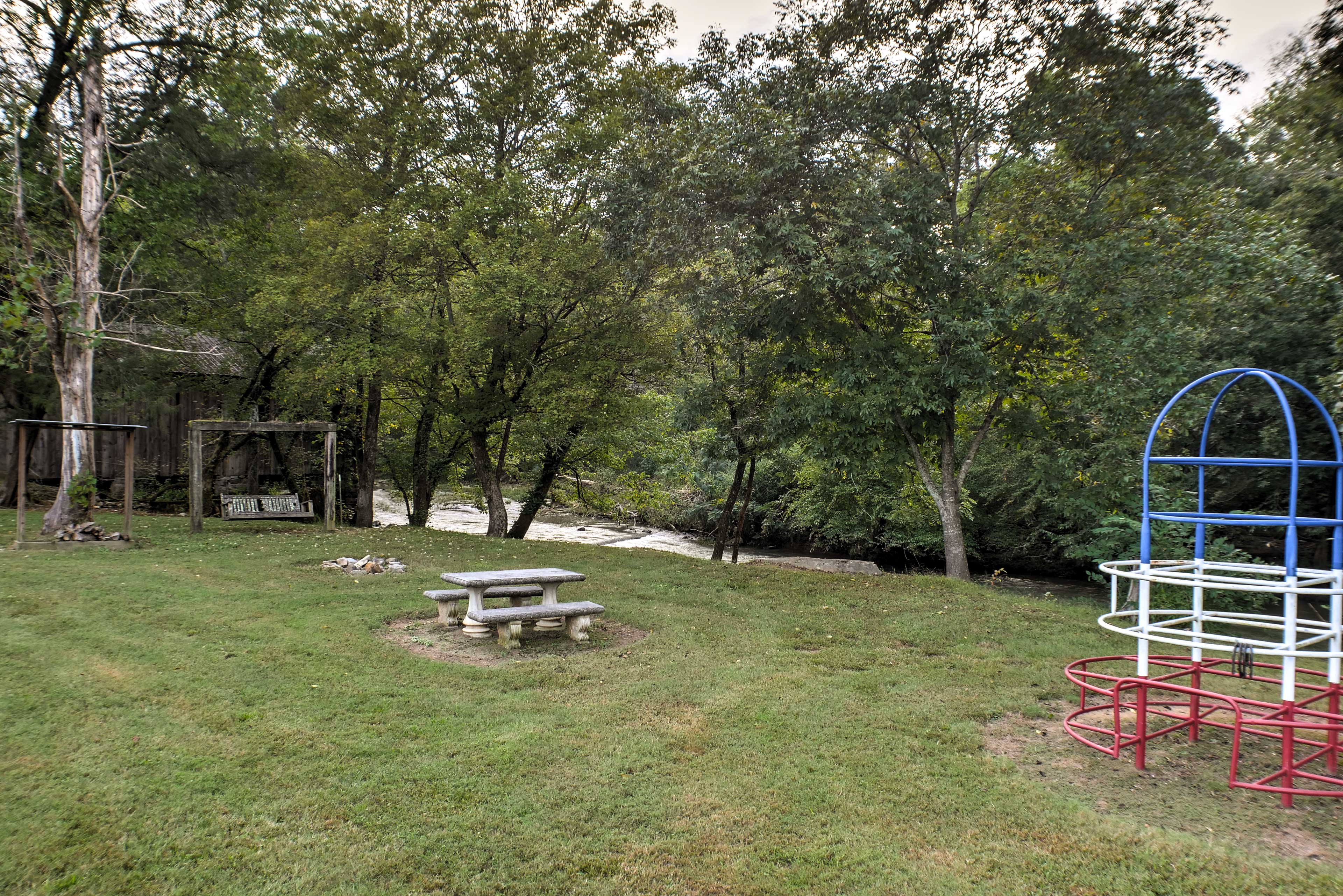The amenities include the jungle gym, picnic table and swings.