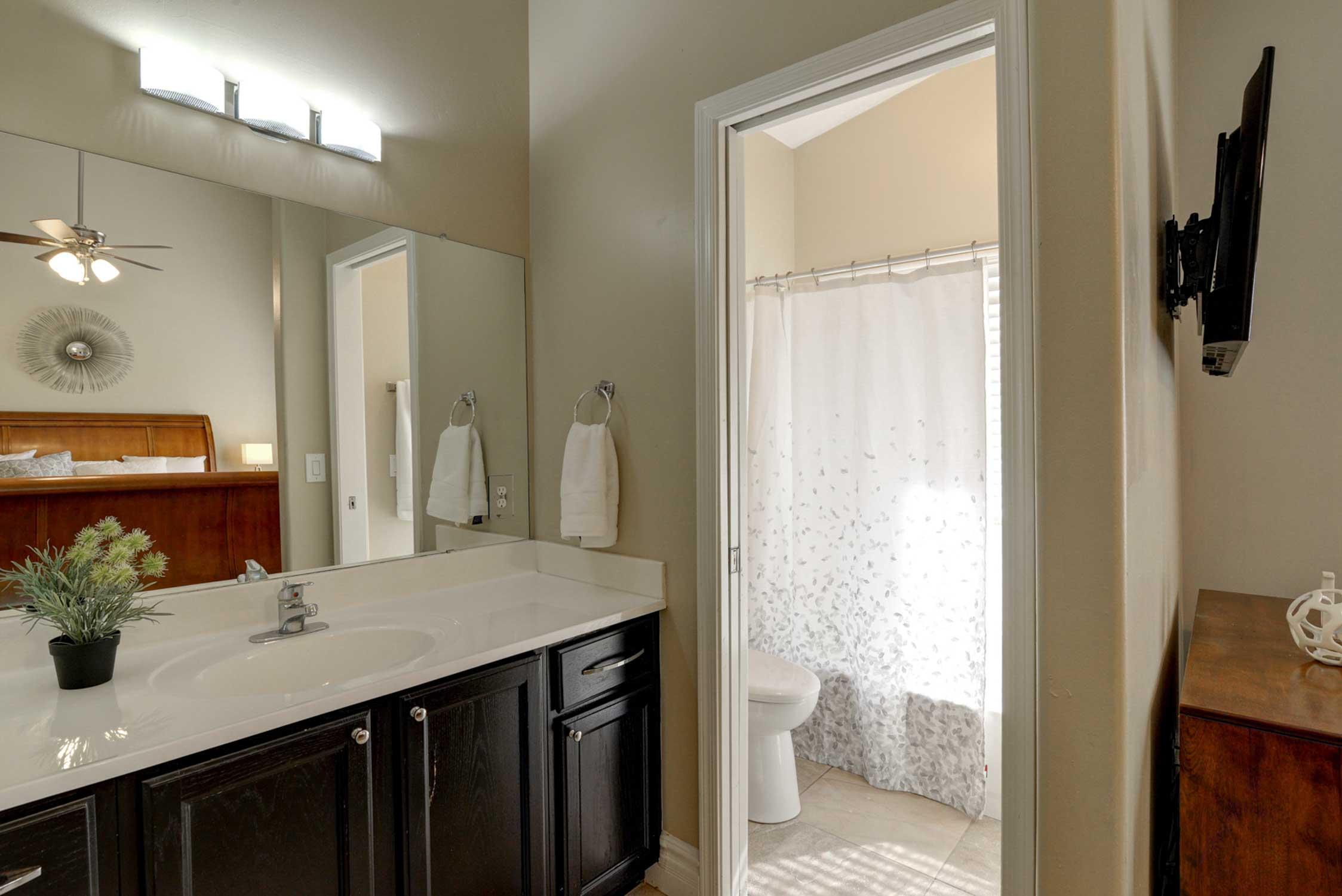 The bedroom opens up to an en-suite bathroom.