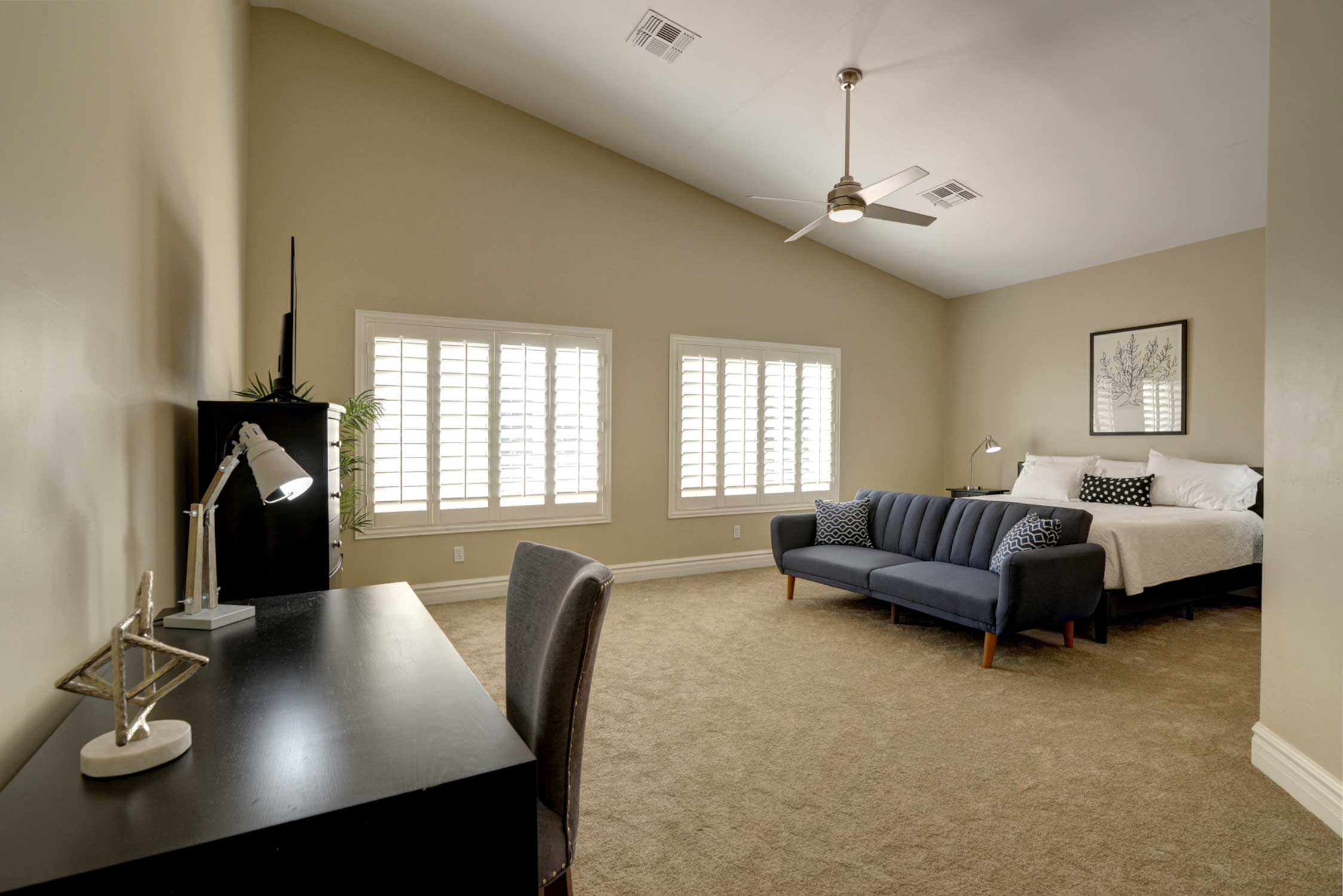 This bedroom includes a king bed & flat-screen TV with streaming capabilities.