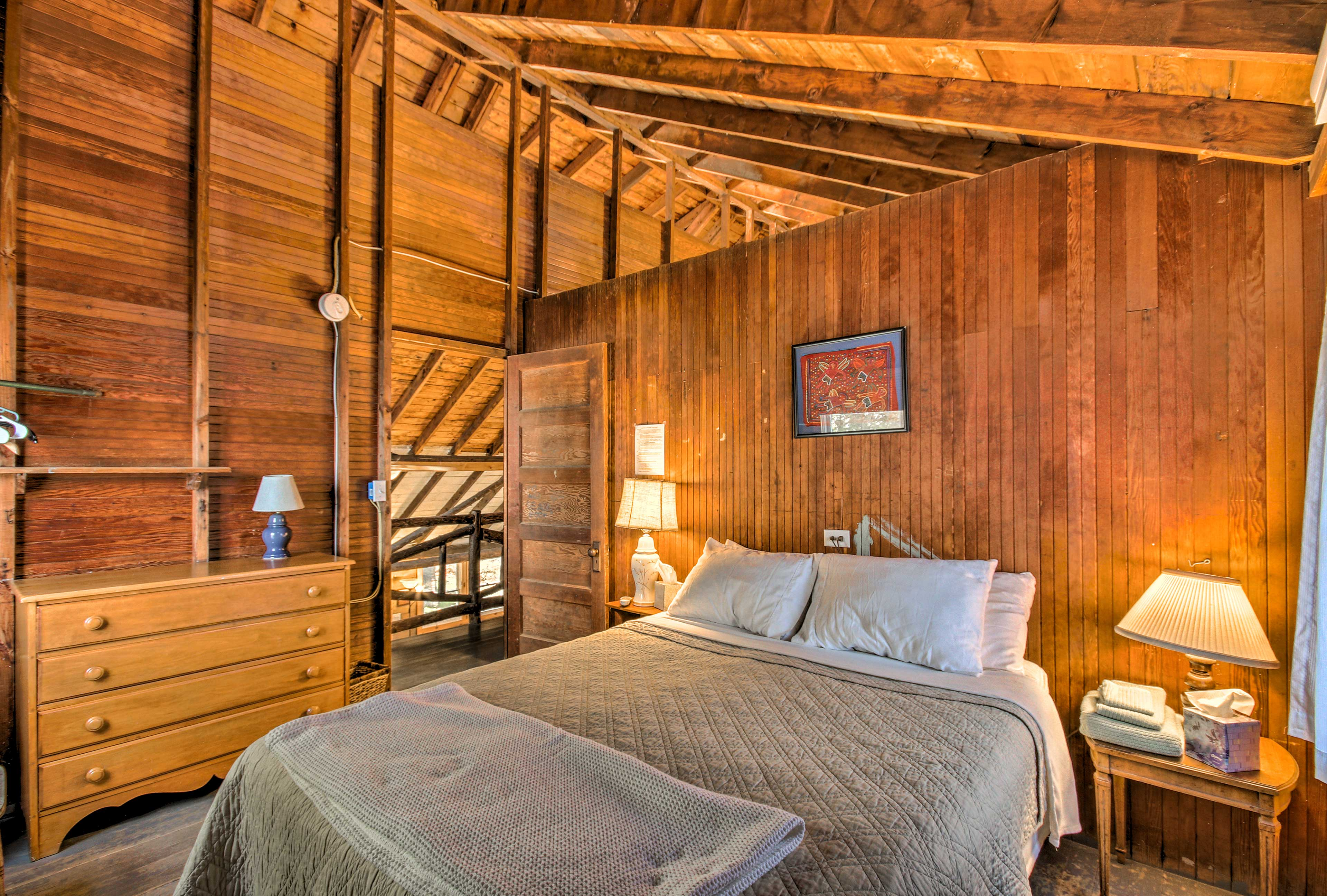 Sleep soundly in this home's first upstairs bedroom.
