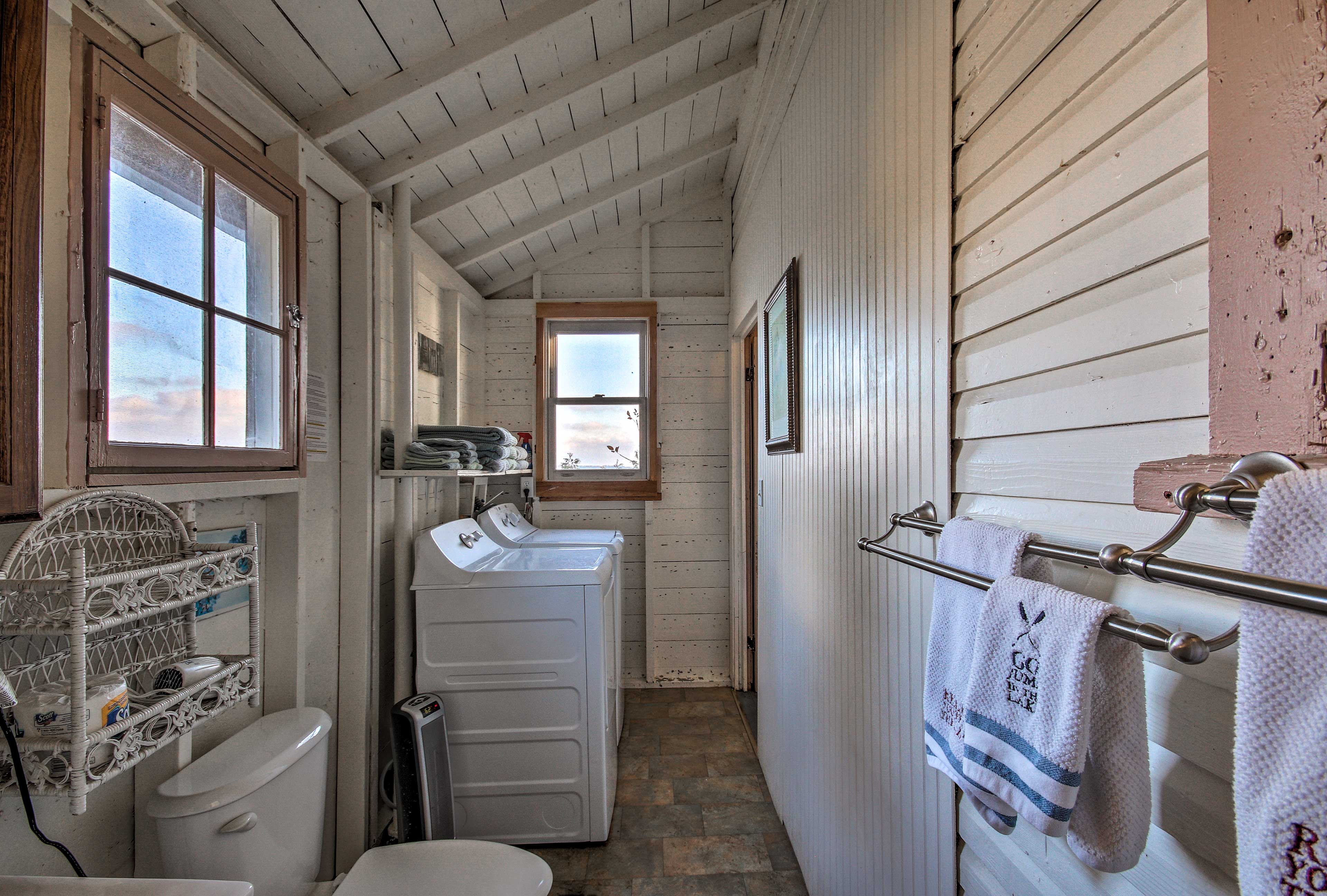 The full-sized laundry machines are located in the main bathroom.