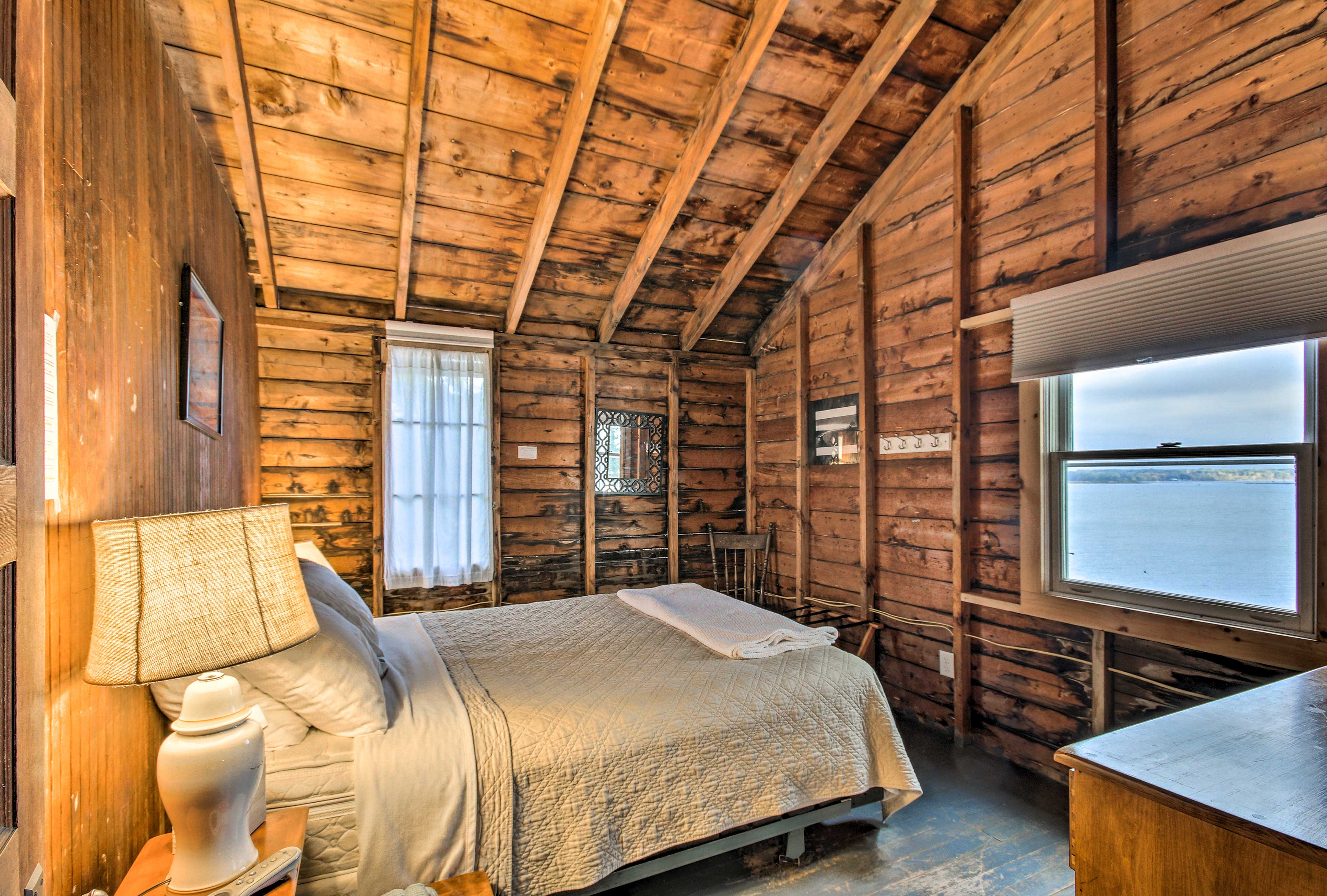 The 1st upstairs bedroom, one of 2 queen bedrooms, boasts a beautiful lake view.