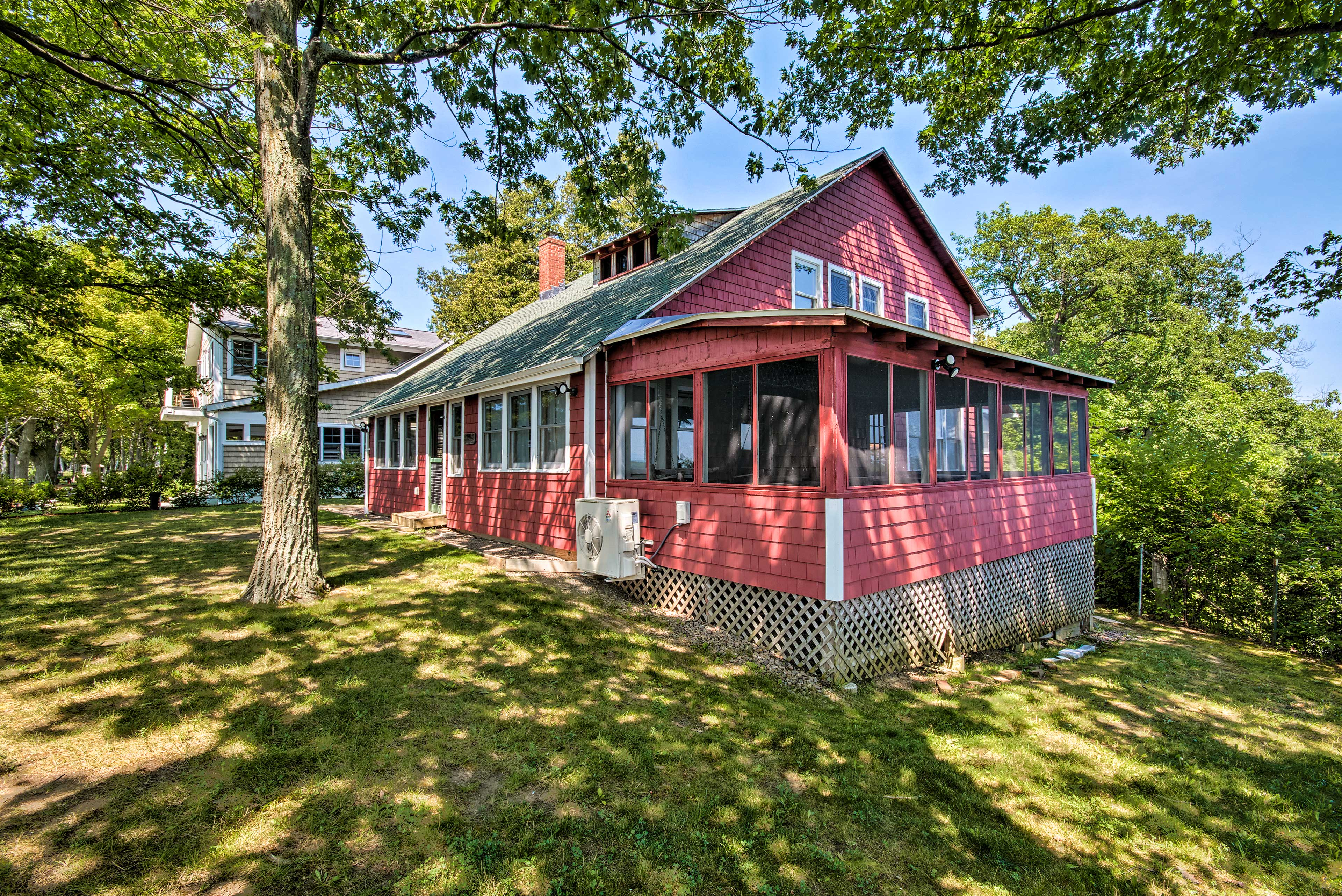 The spacious screened-in porch faces the lake & boasts breathtaking views.