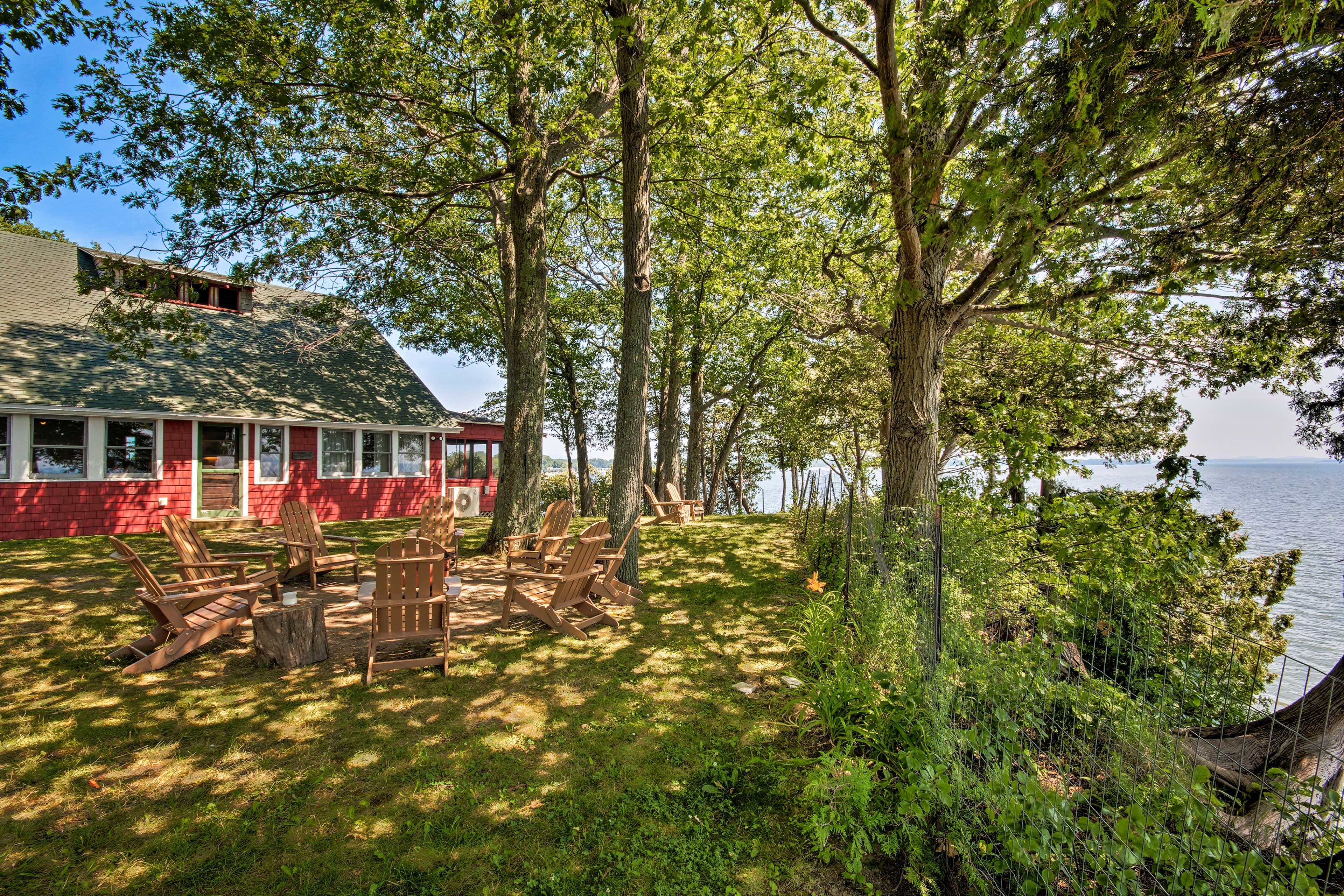 This renovated 1920's lake house features a charming red exterior.