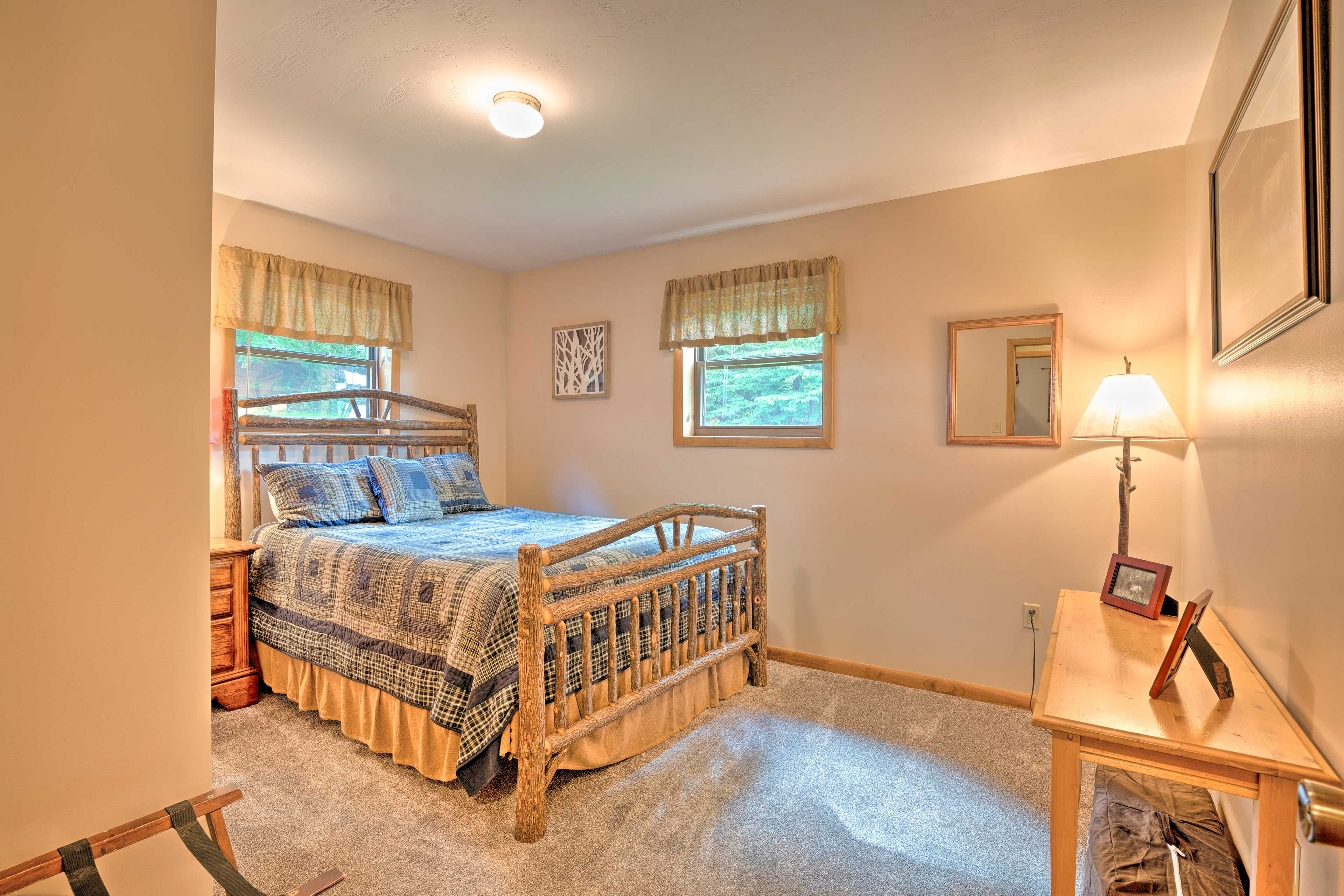 A queen bed highlights this bedroom.