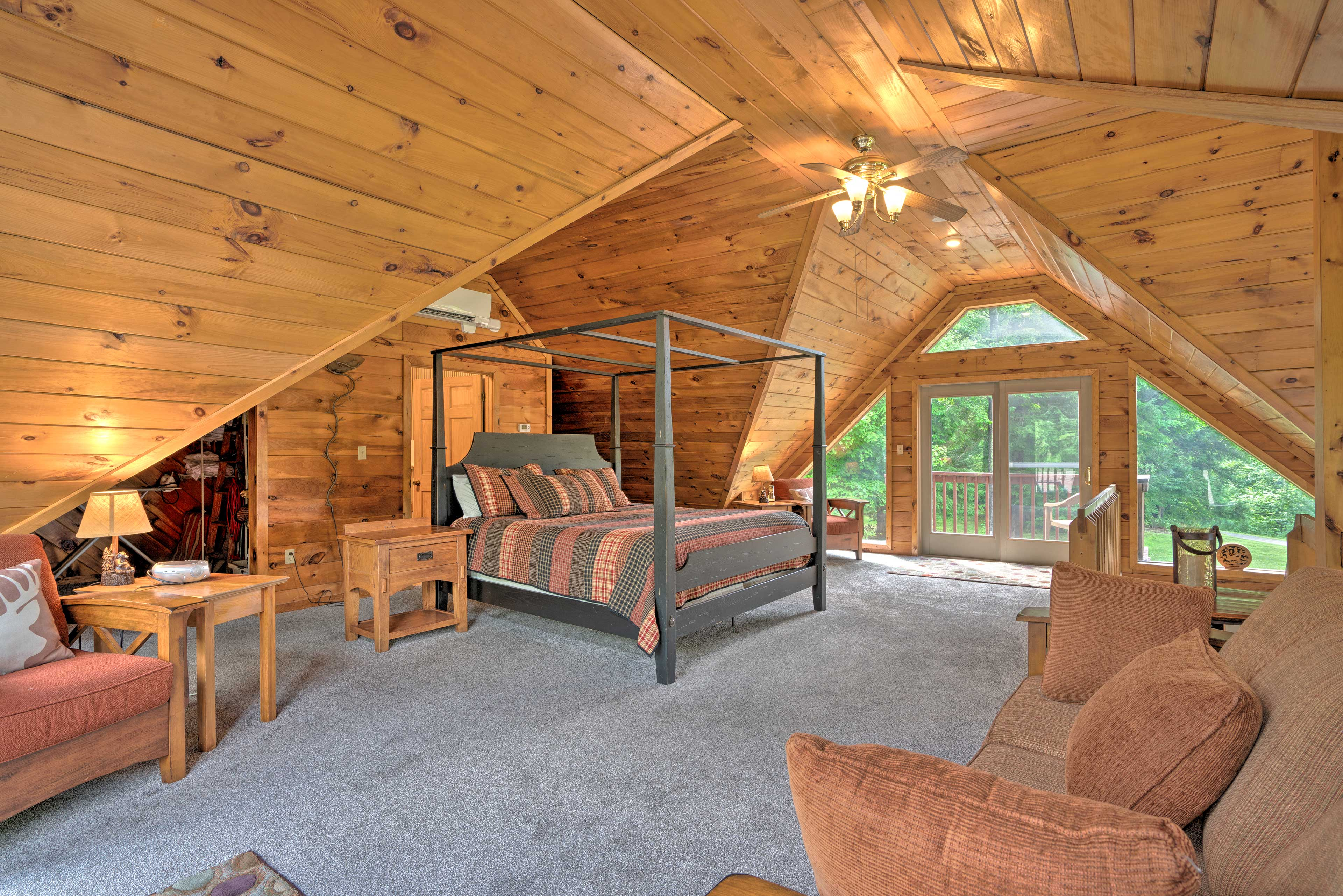The spacious loft is complete with a king bed.