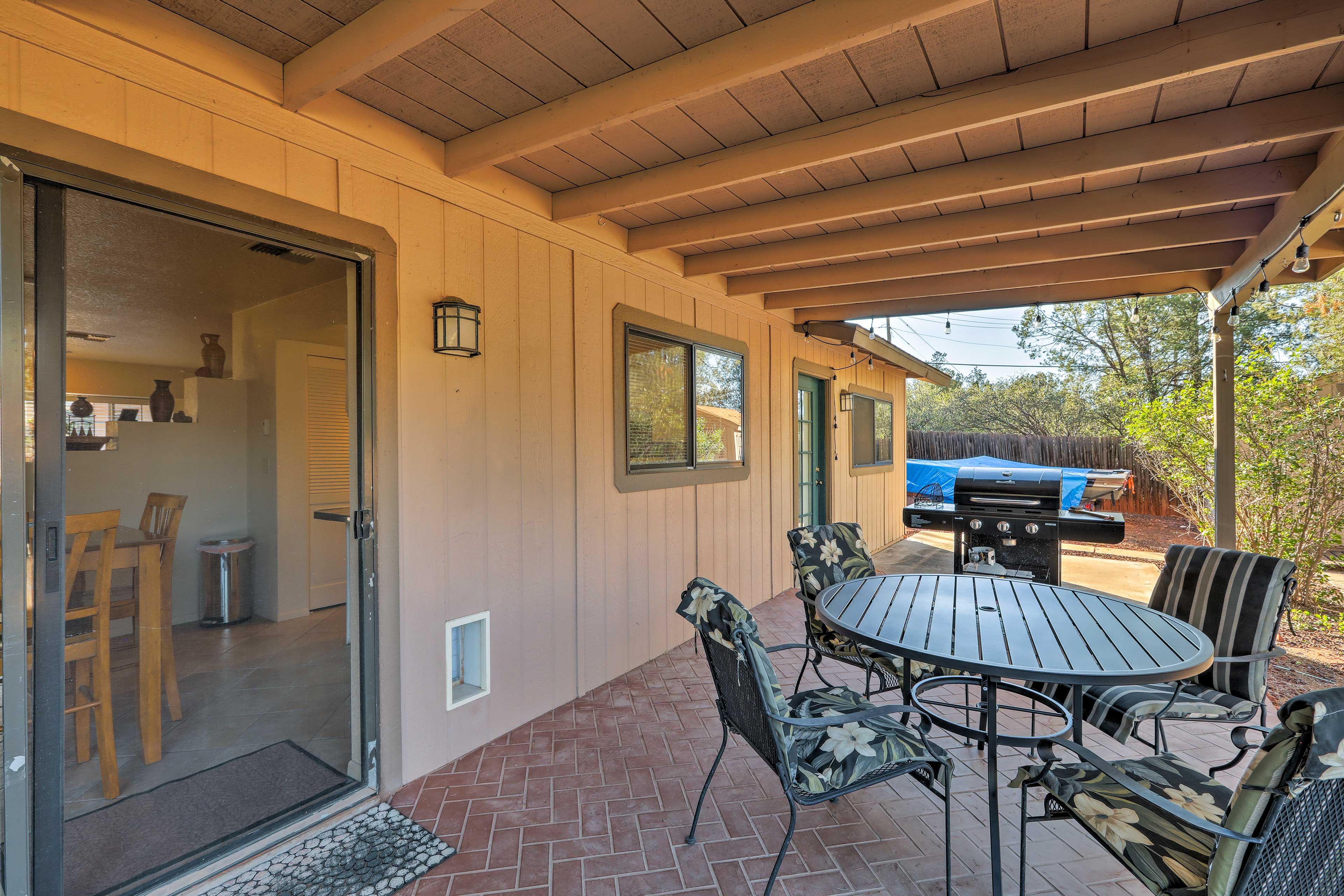Relax on the private patio during your stay at this vacation rental house!