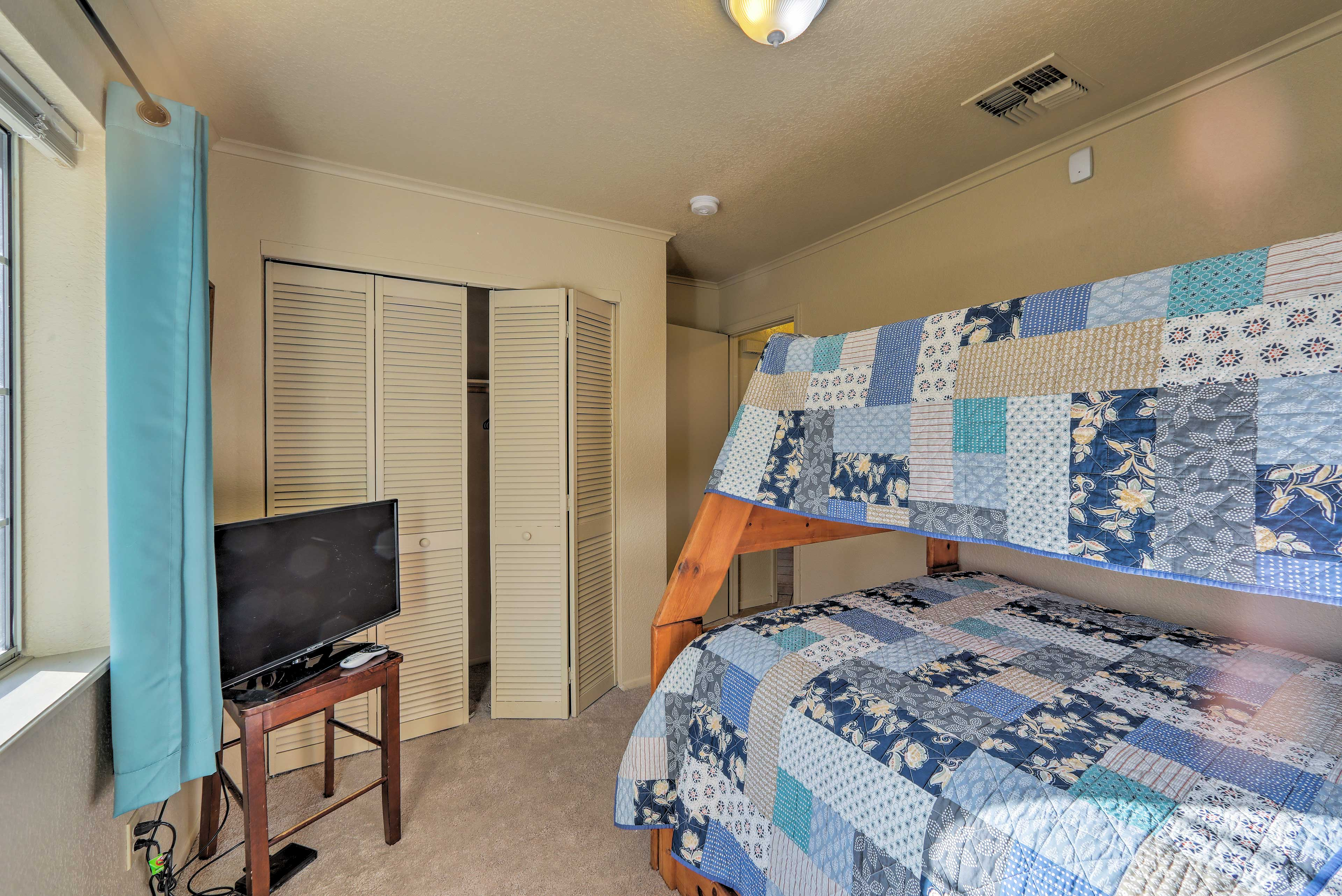 This room has a twin-over-full bunk bed and a flat-screen TV!