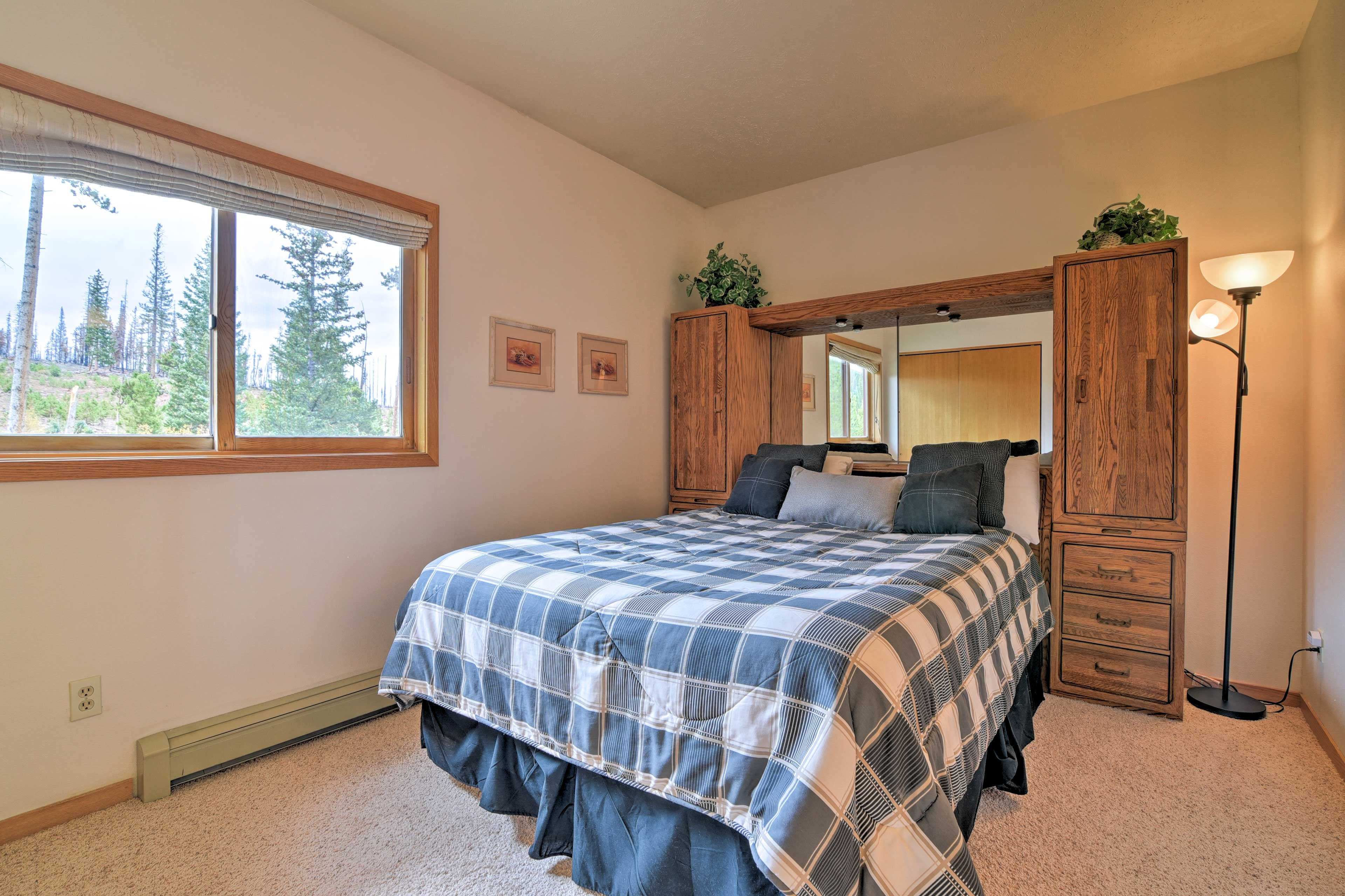 The master bedroom boasts a queen bed.
