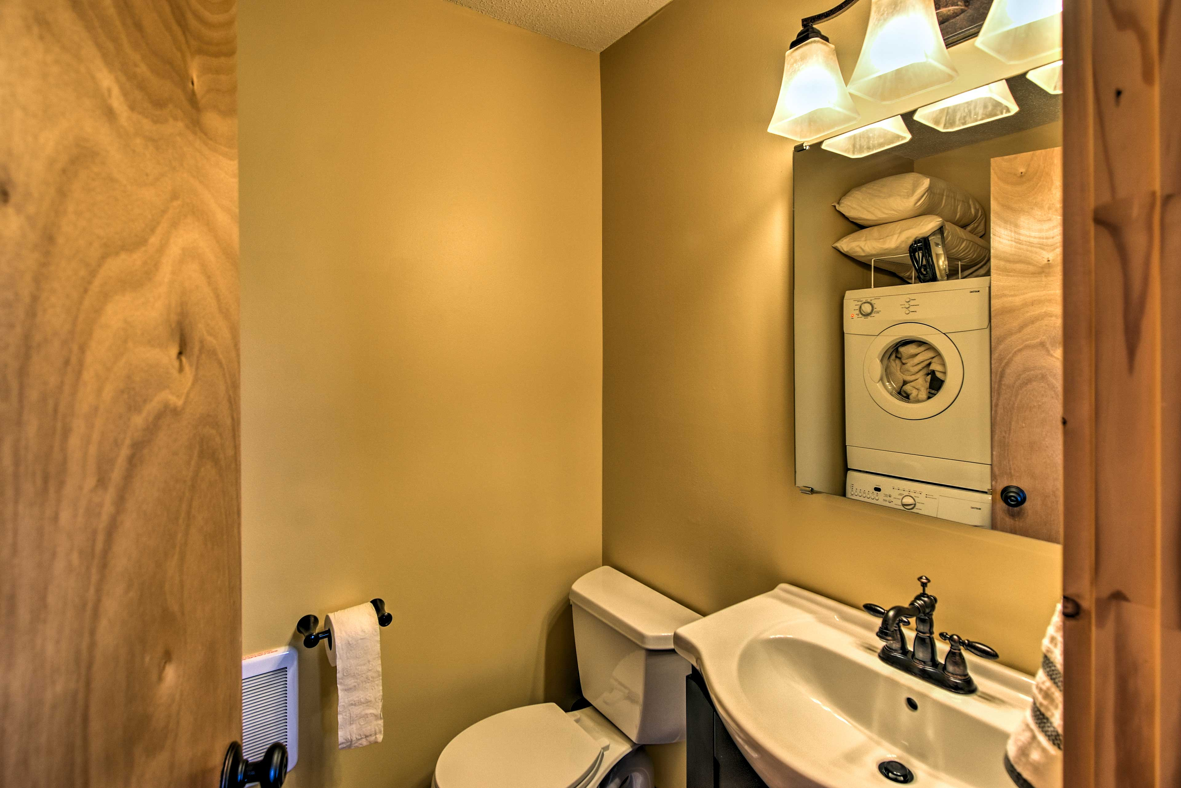 The washer and dryer is located in the half bathroom.