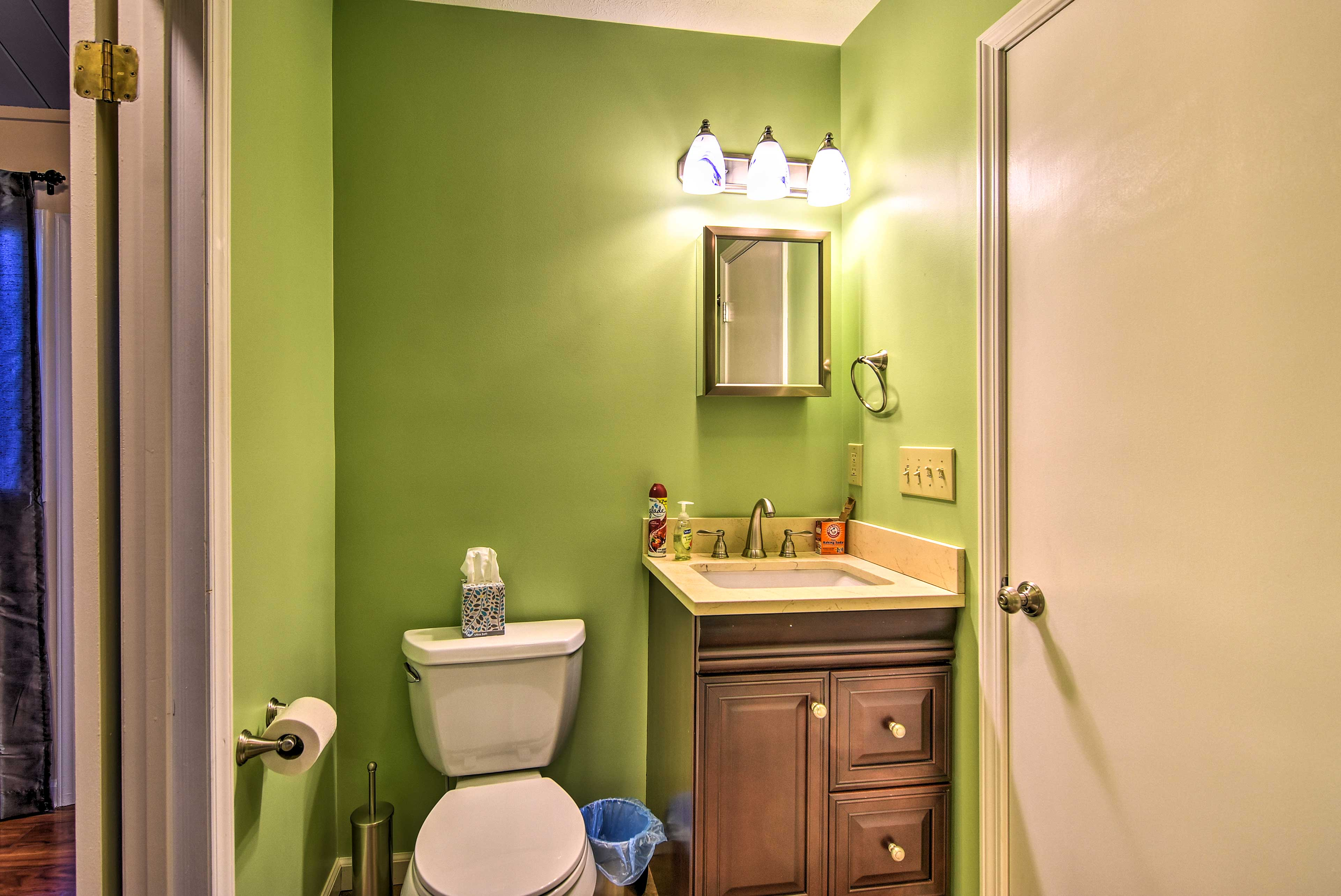 Guests can wash up at the mirrored vanity in the second bathroom.
