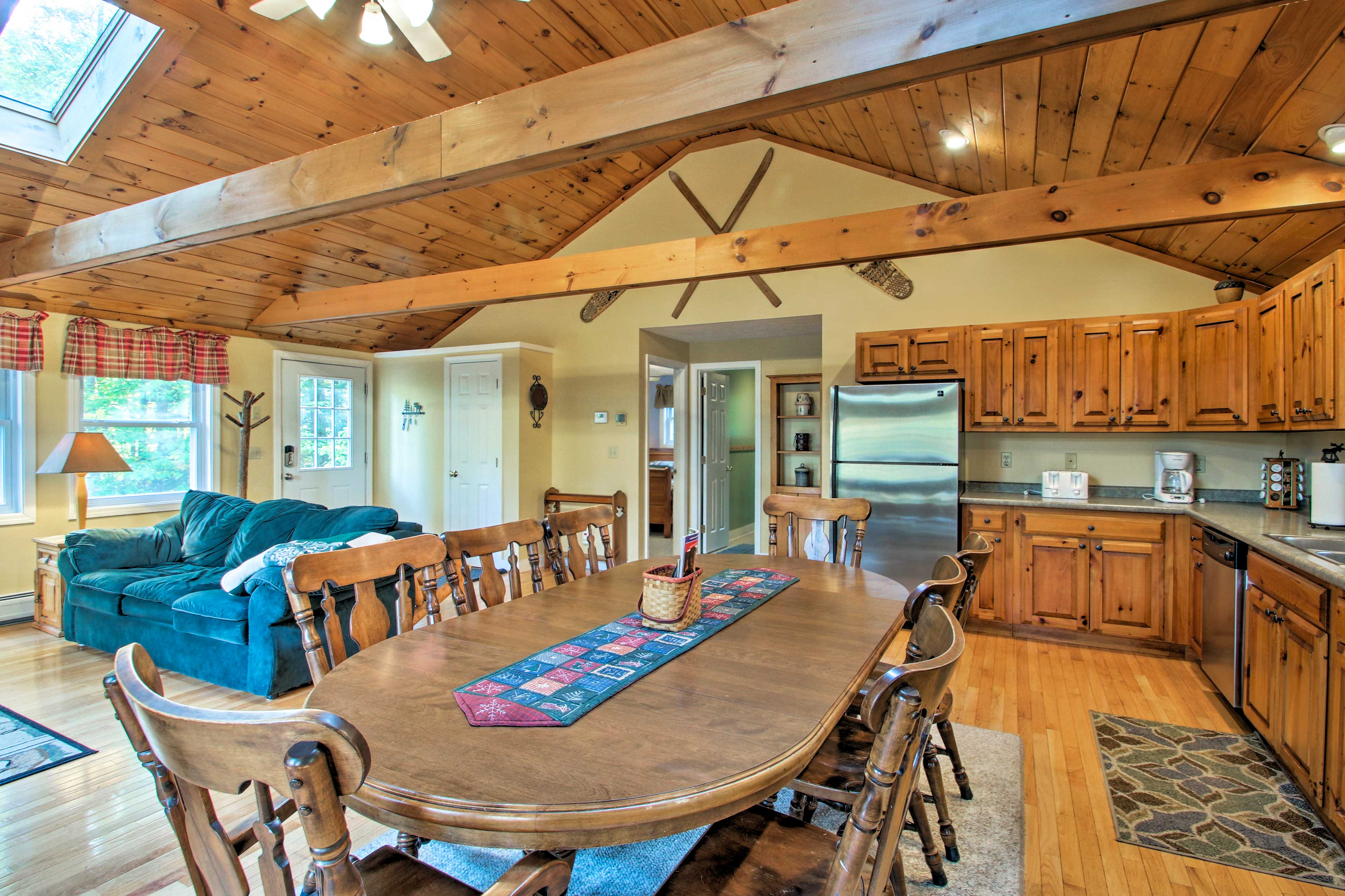 The living area opens up to the fully equipped kitchen, with ample cookware!