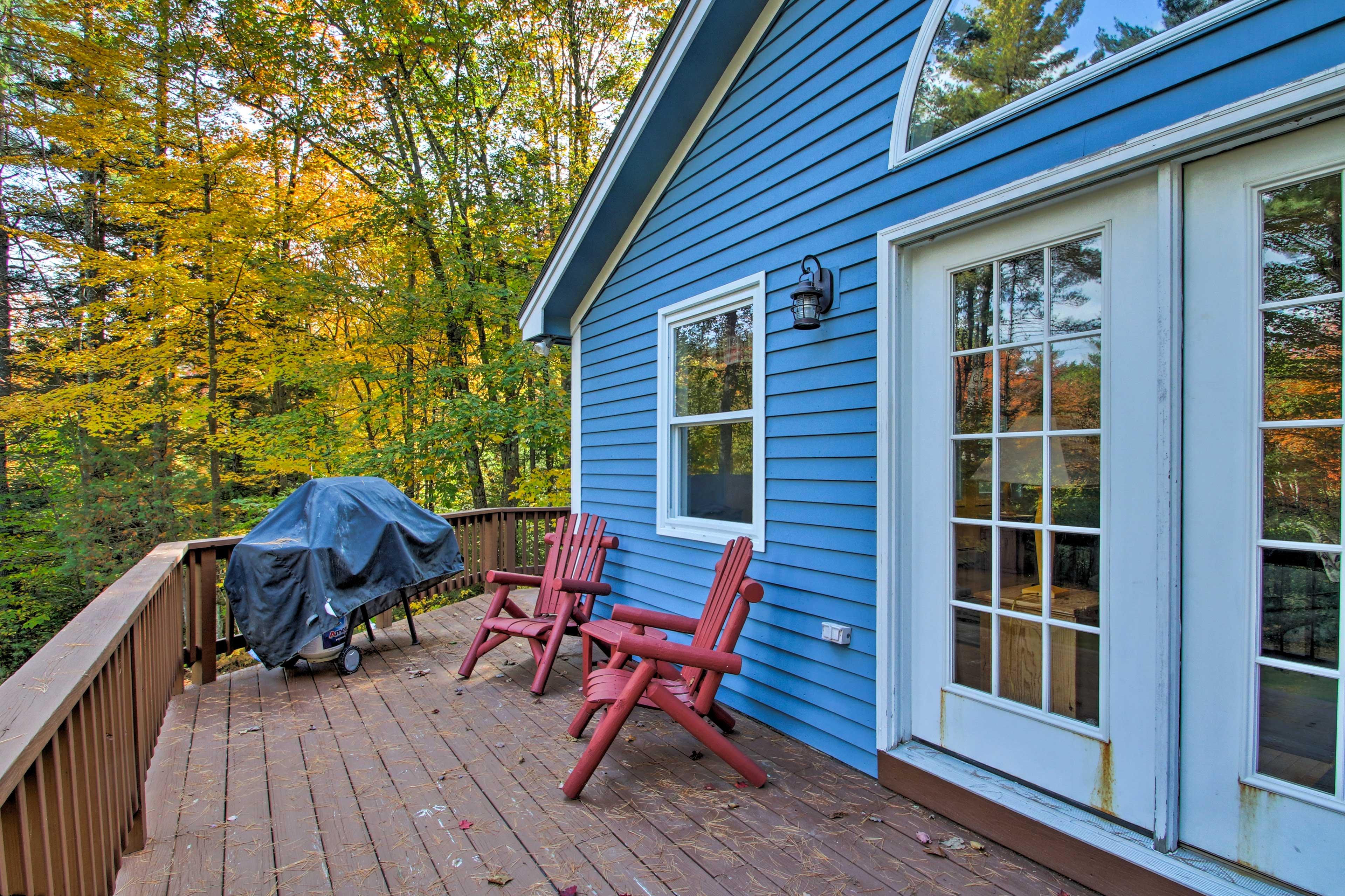 Relax on the deck, furnished with chairs and a gas grill.