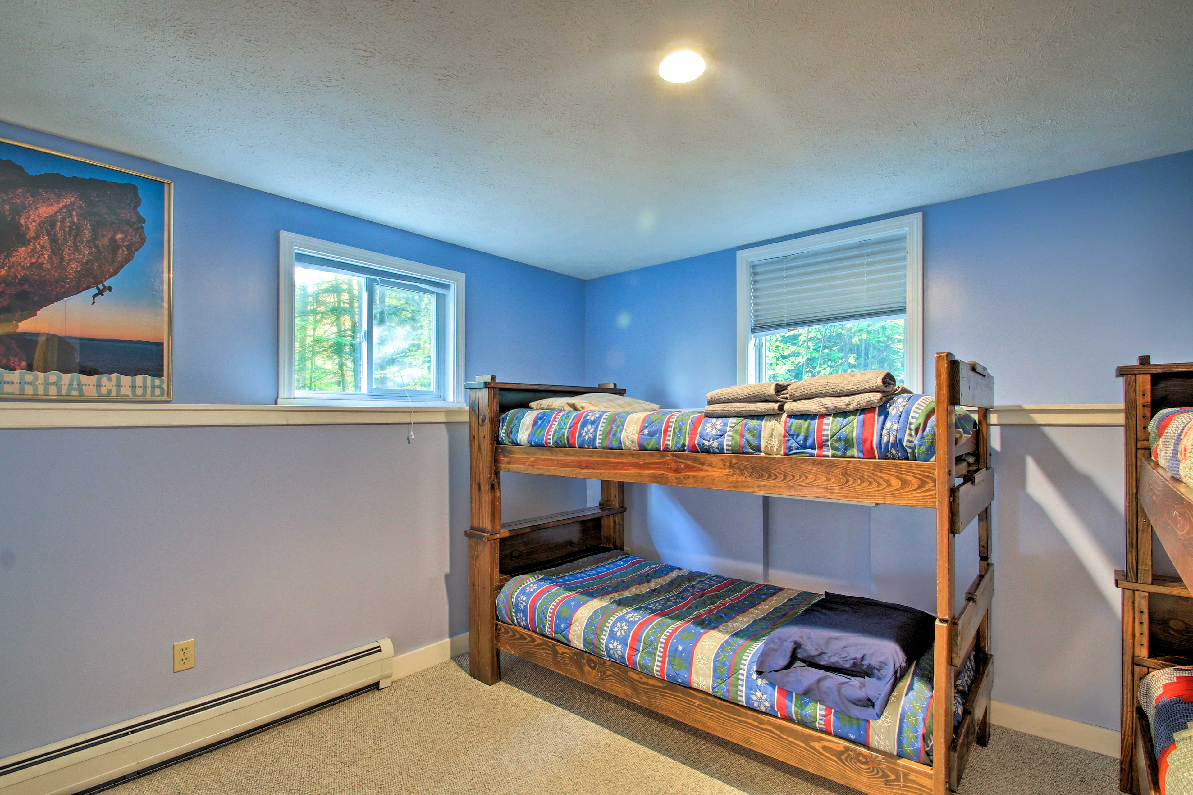 This bedroom, with 2 twin-over-twin bunk beds, is perfect for kids!