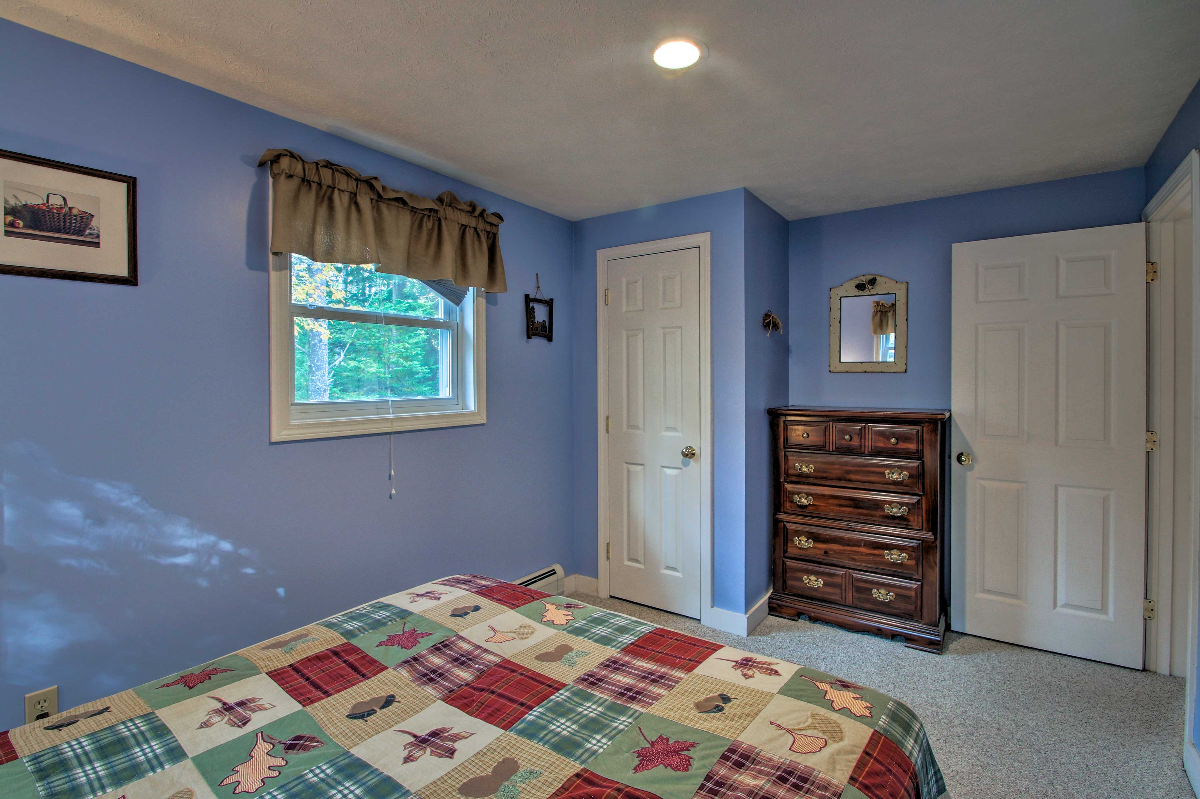 This bedroom also features ample storage space.