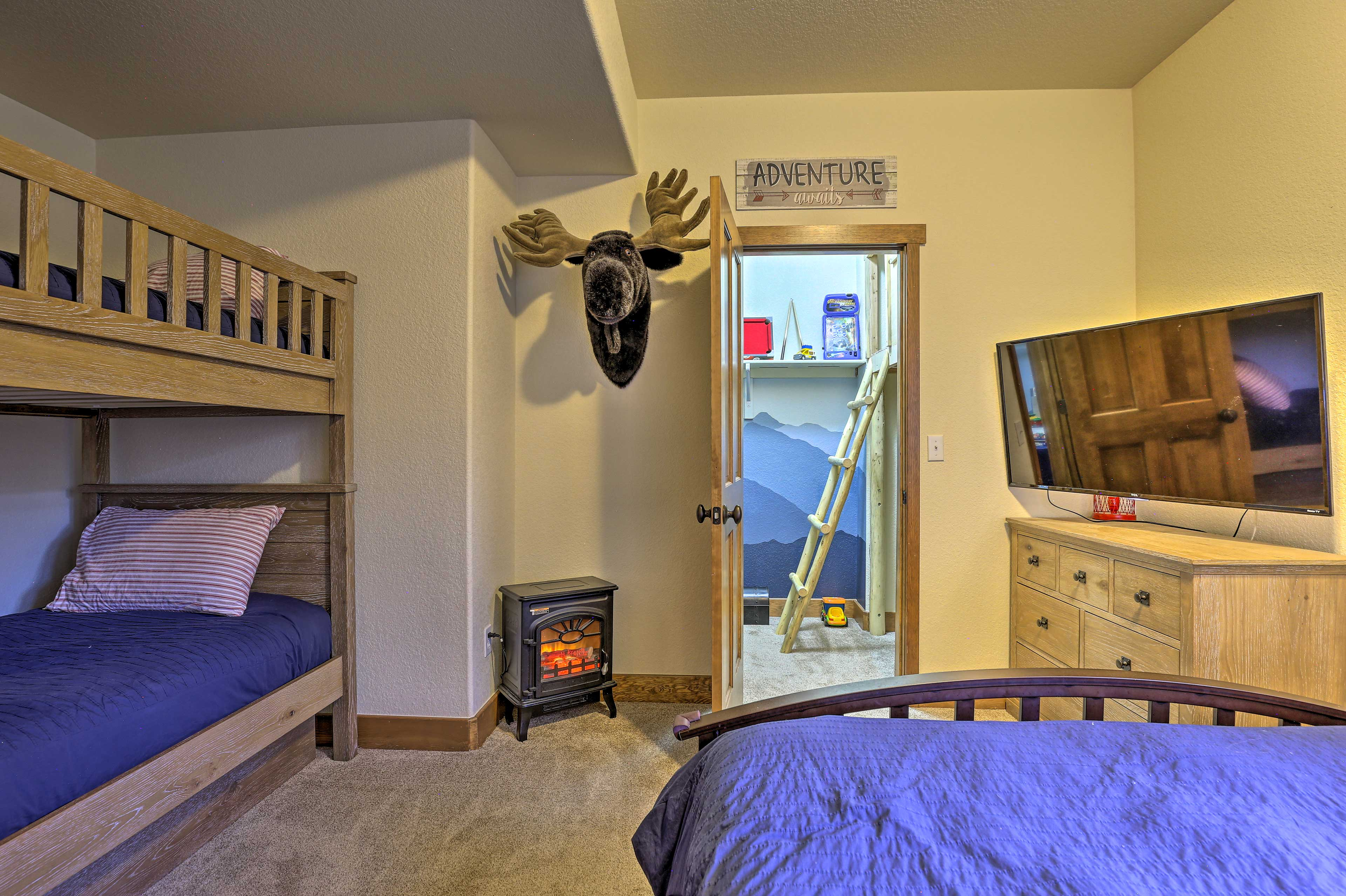 This last bedroom houses a queen bed and twin bunk bed.