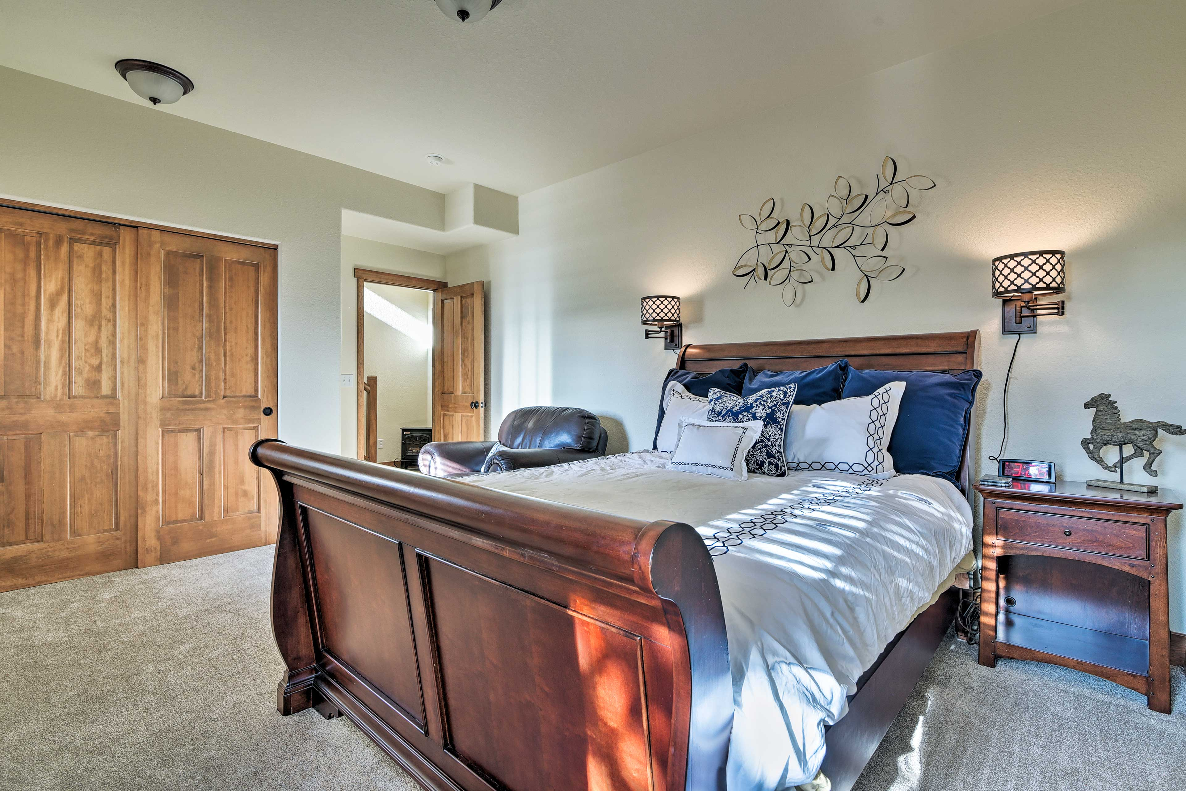 A queen bed and electric fireplace finish off this bedroom.