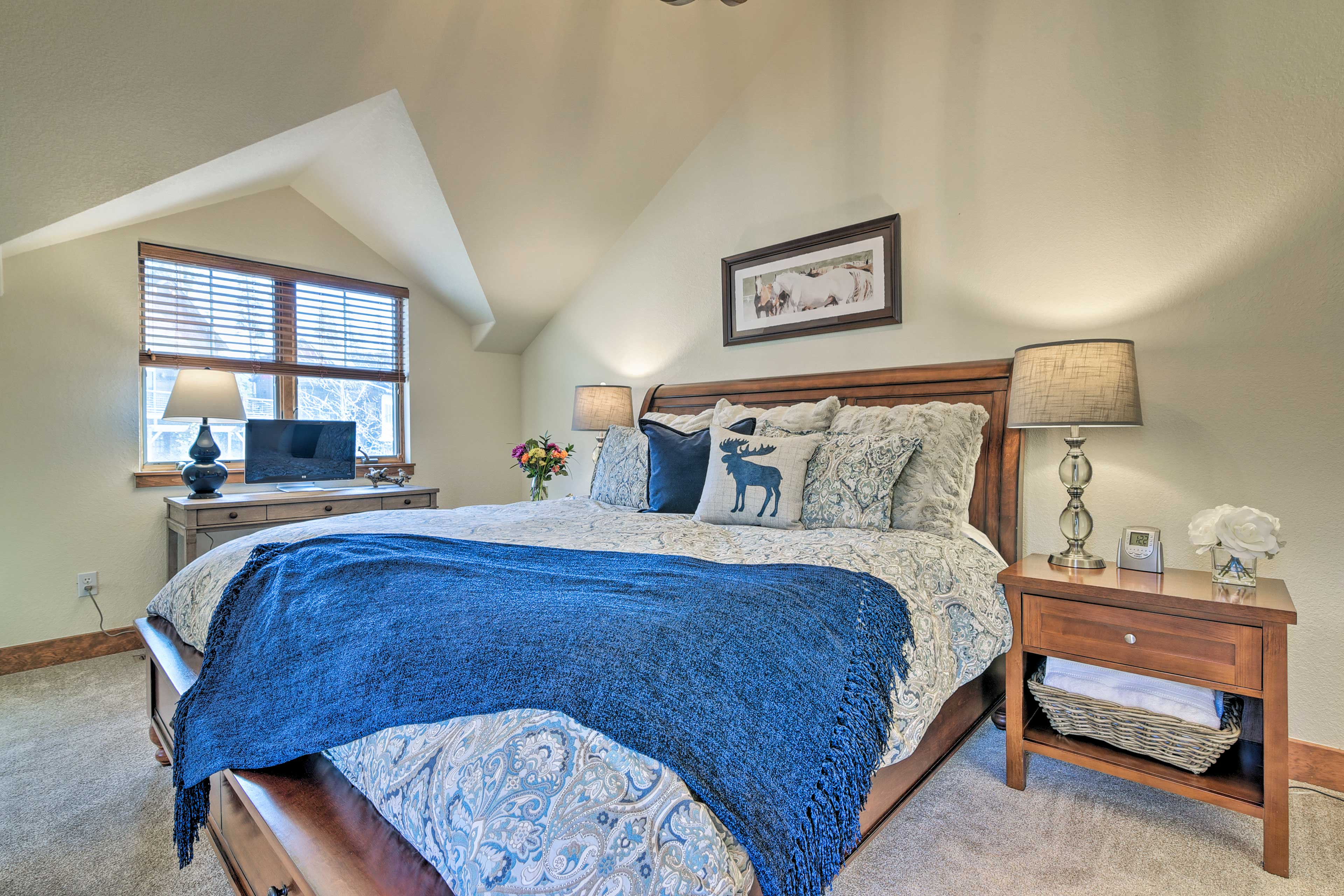 This first master suite features a king-sized bed.
