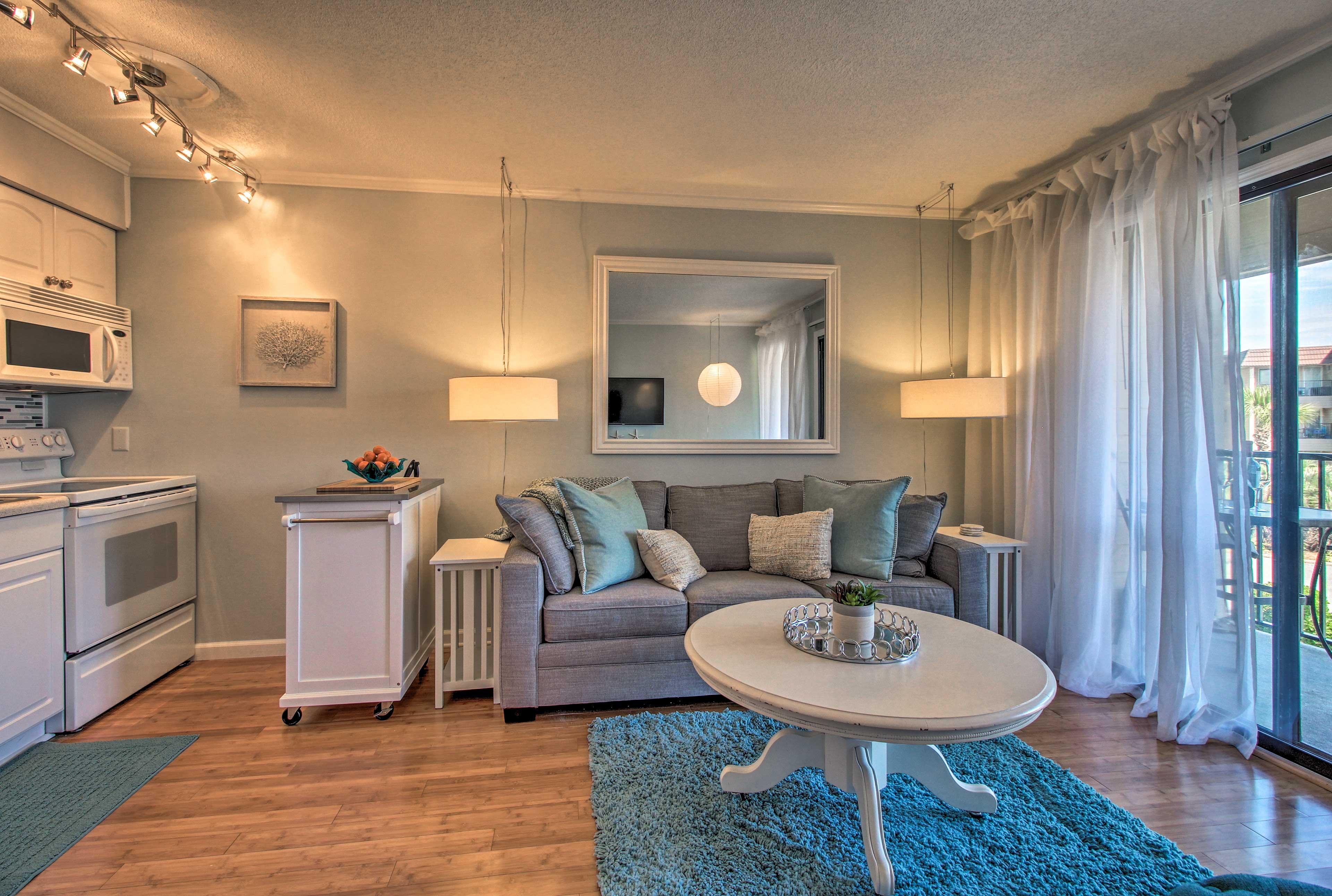 Coastal decor and plush furnishings elevate this home.