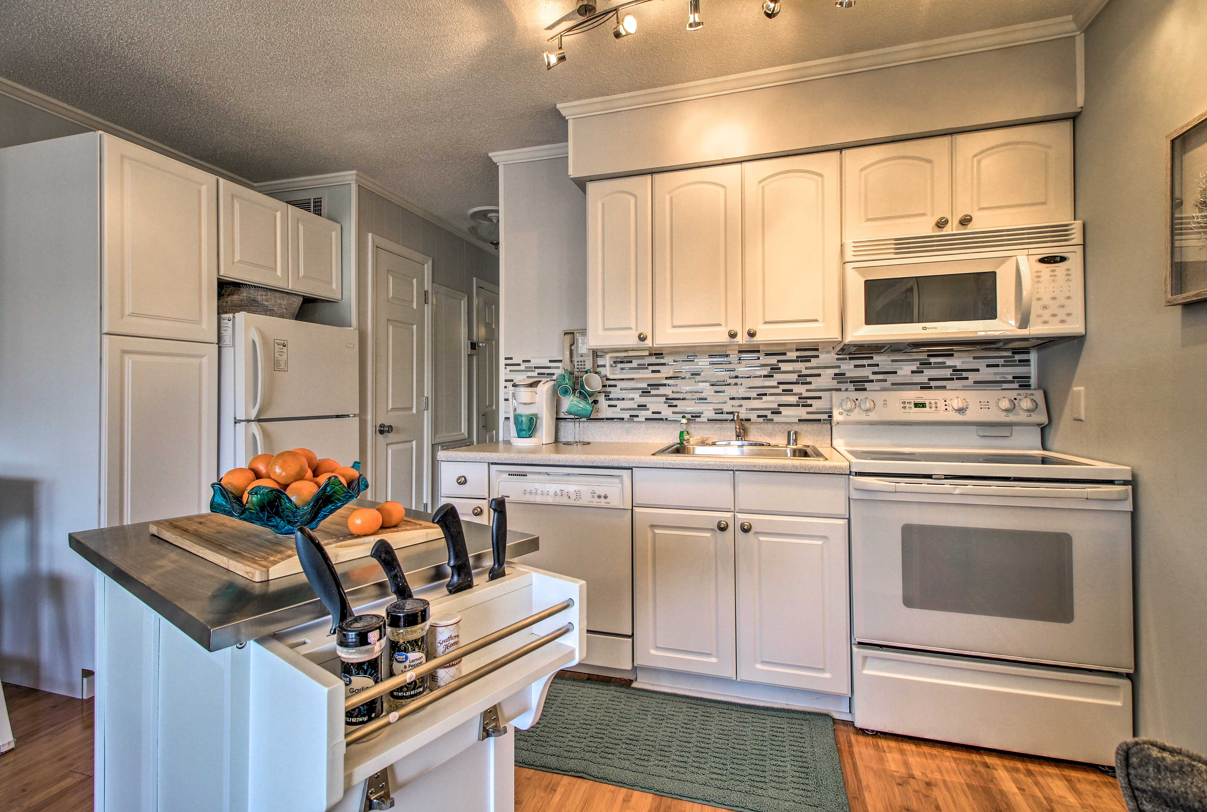This kitchen is complete with all of the culinary essentials of home.
