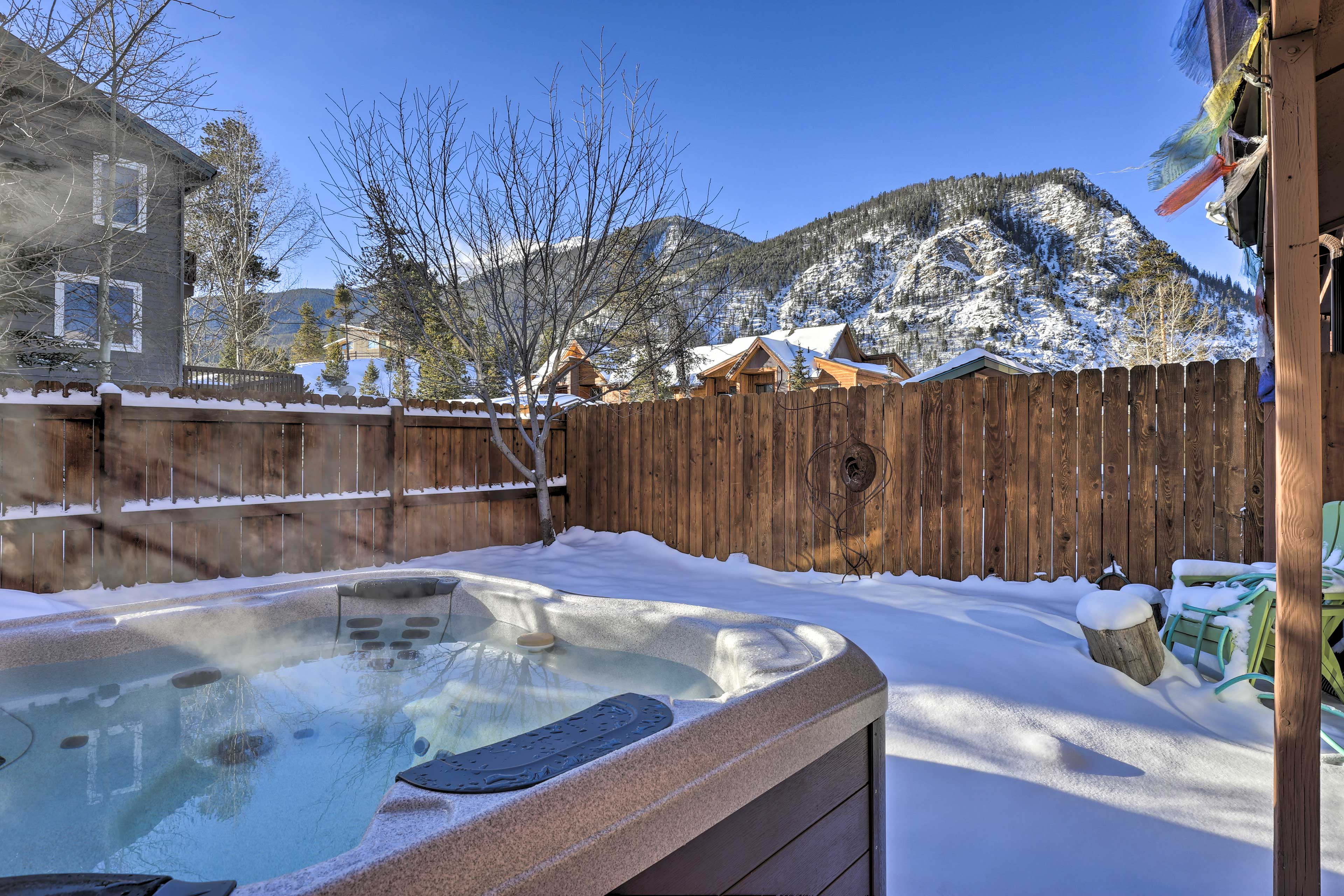 Soak in the new private hot tub looking out at the mountains!