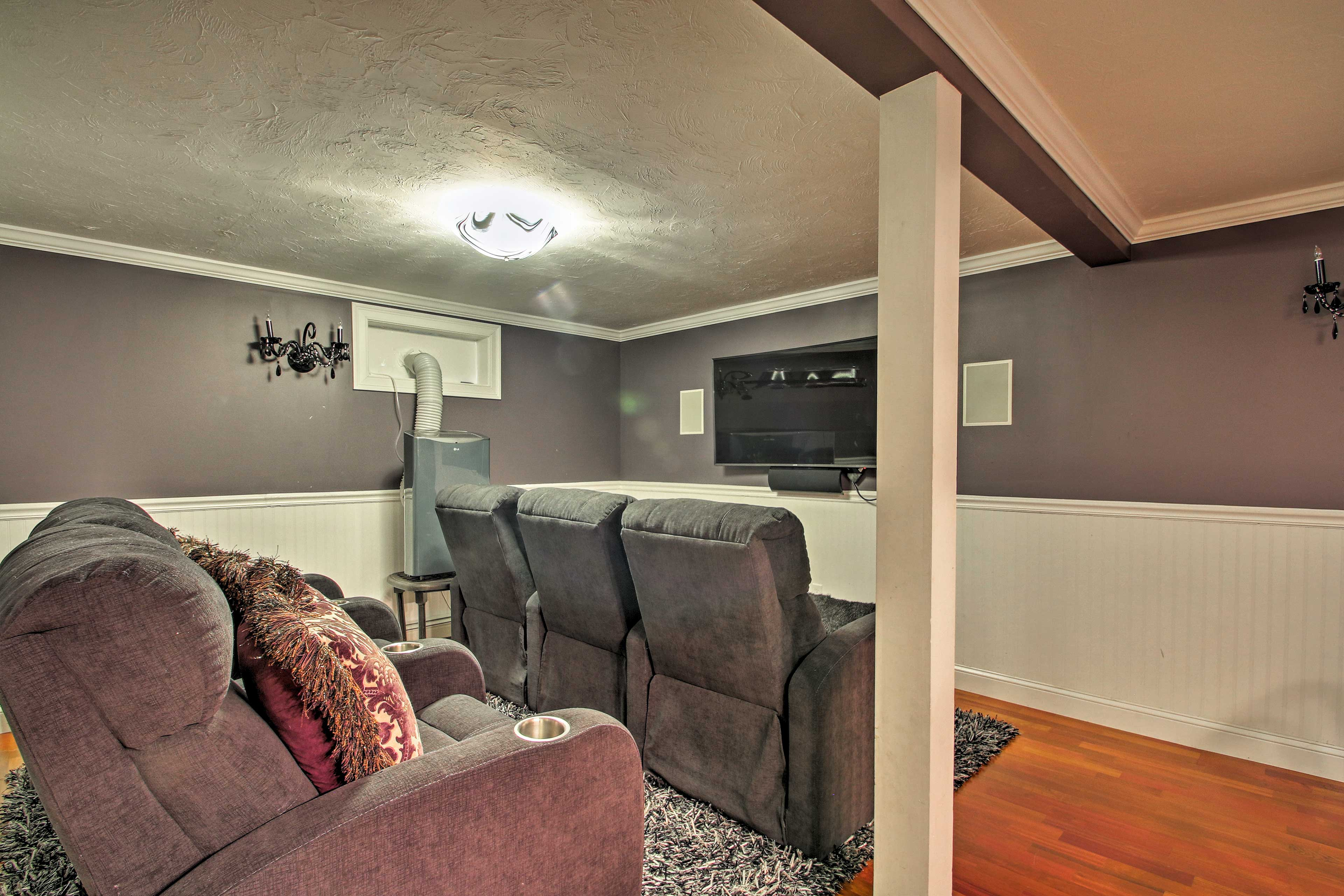 The home features a renovated entertainment space with a 59-inch TV!