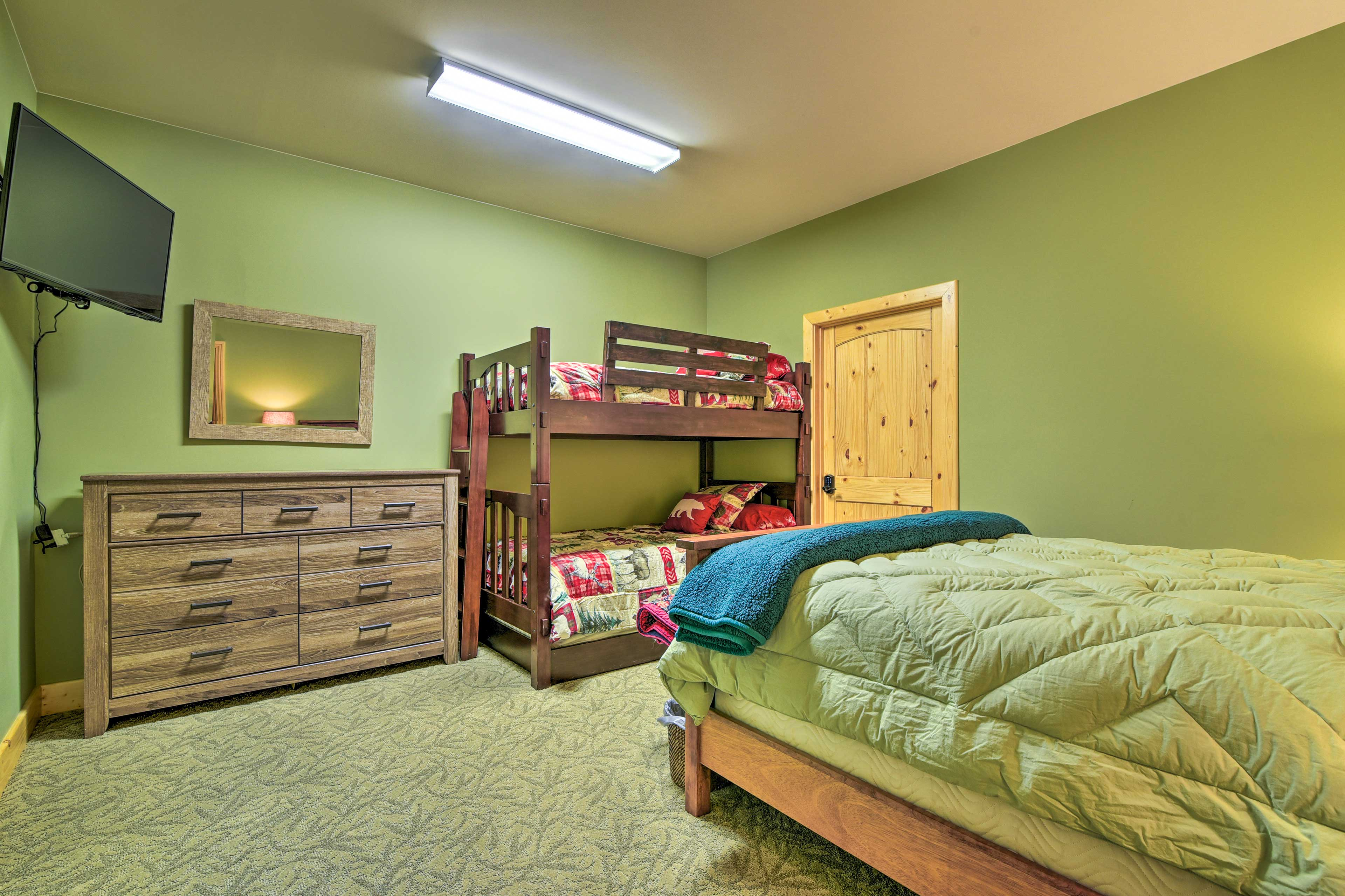 This bedroom has been newly updated and now features a king bed!