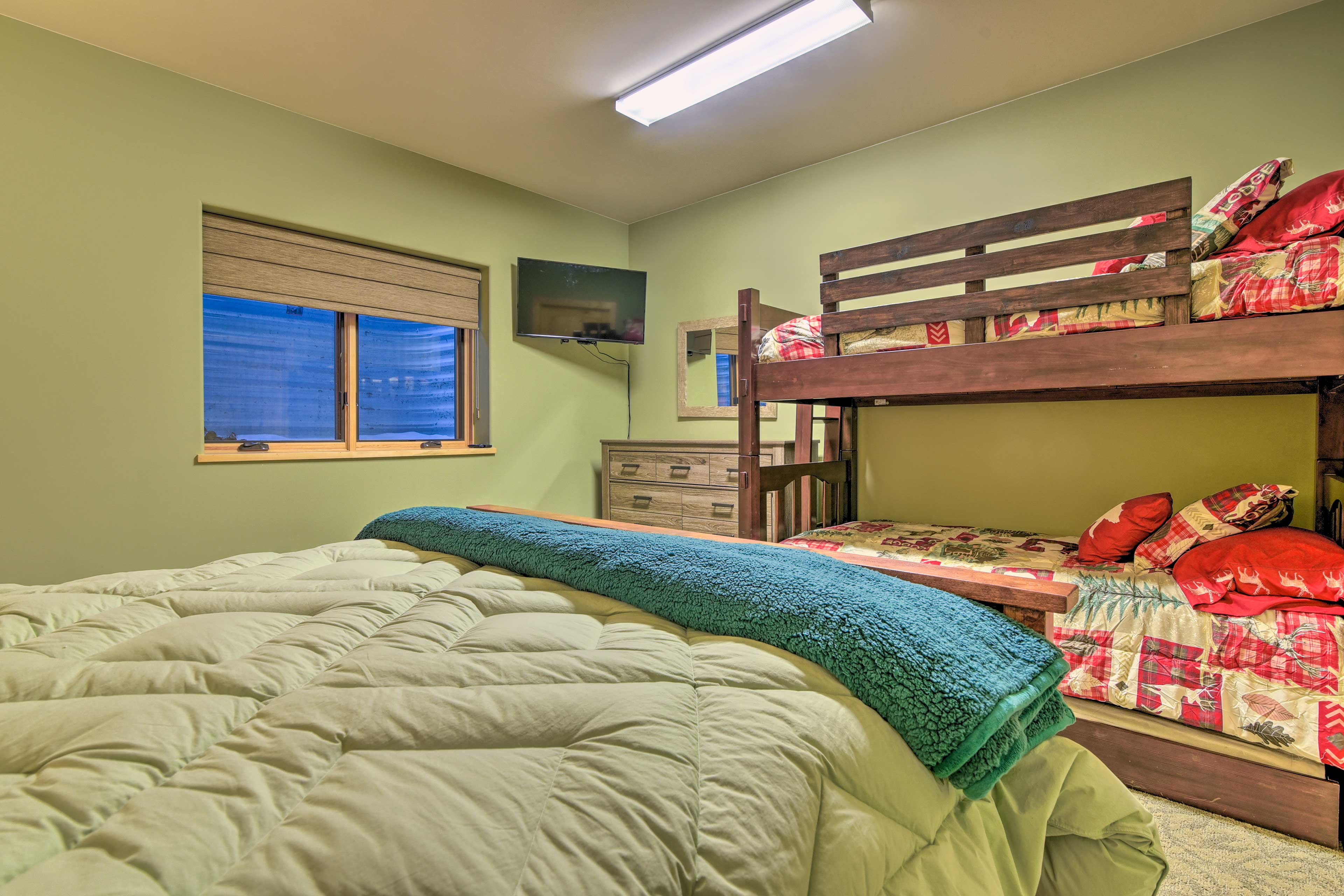 A twin-over-twin bunk bed with a twin trundle is also found in this room.
