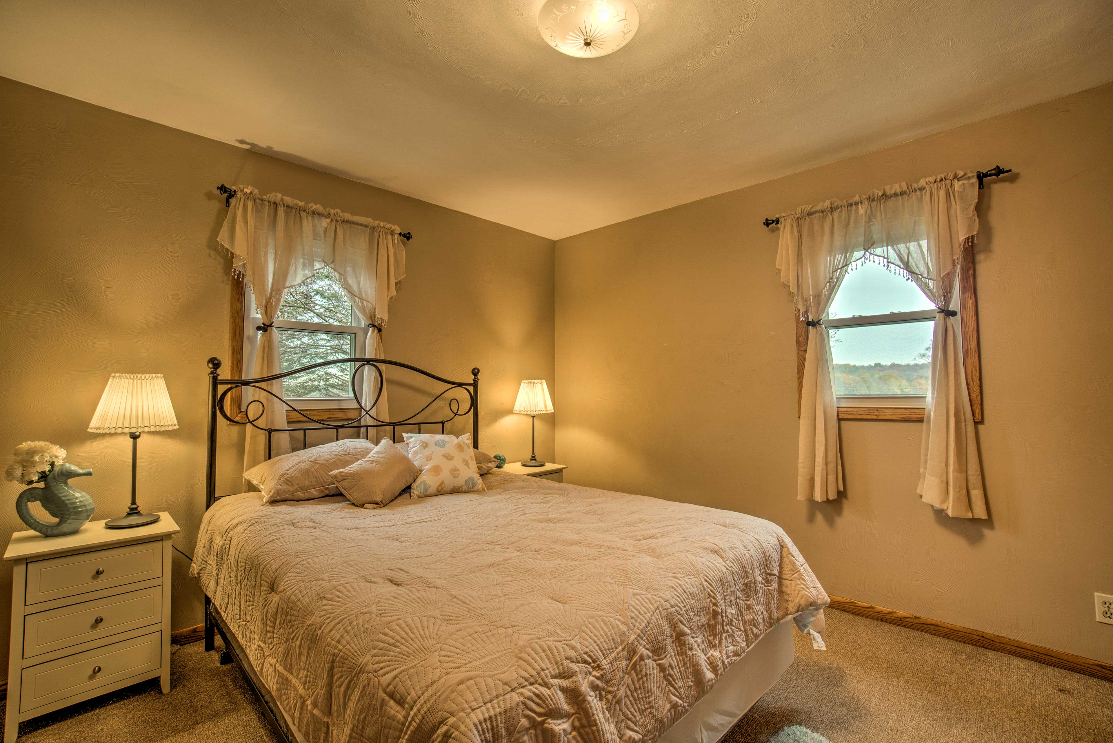 The first bedroom features a queen bed for 2.