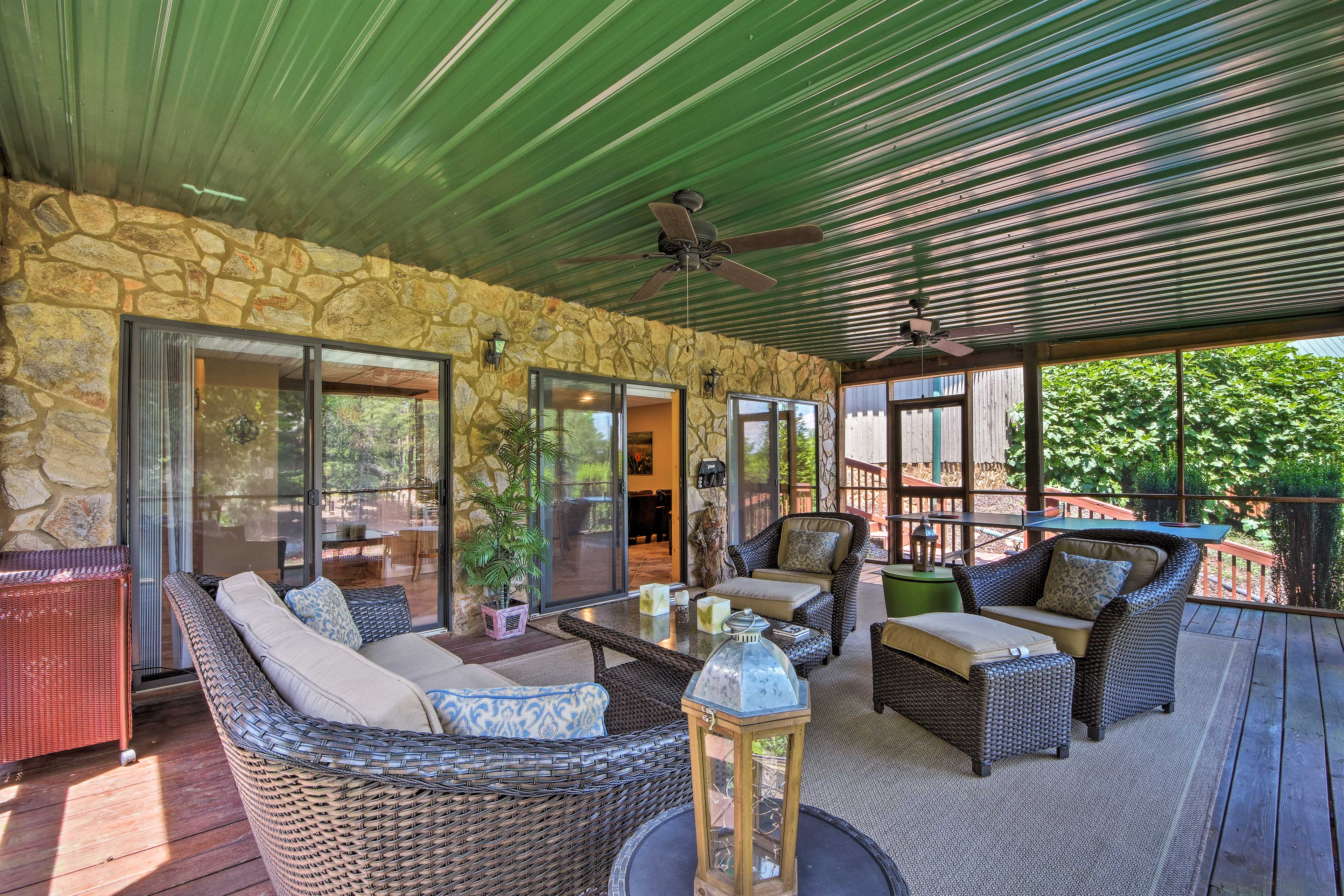 Relax in the screened-in porch surrounded by scenic views.