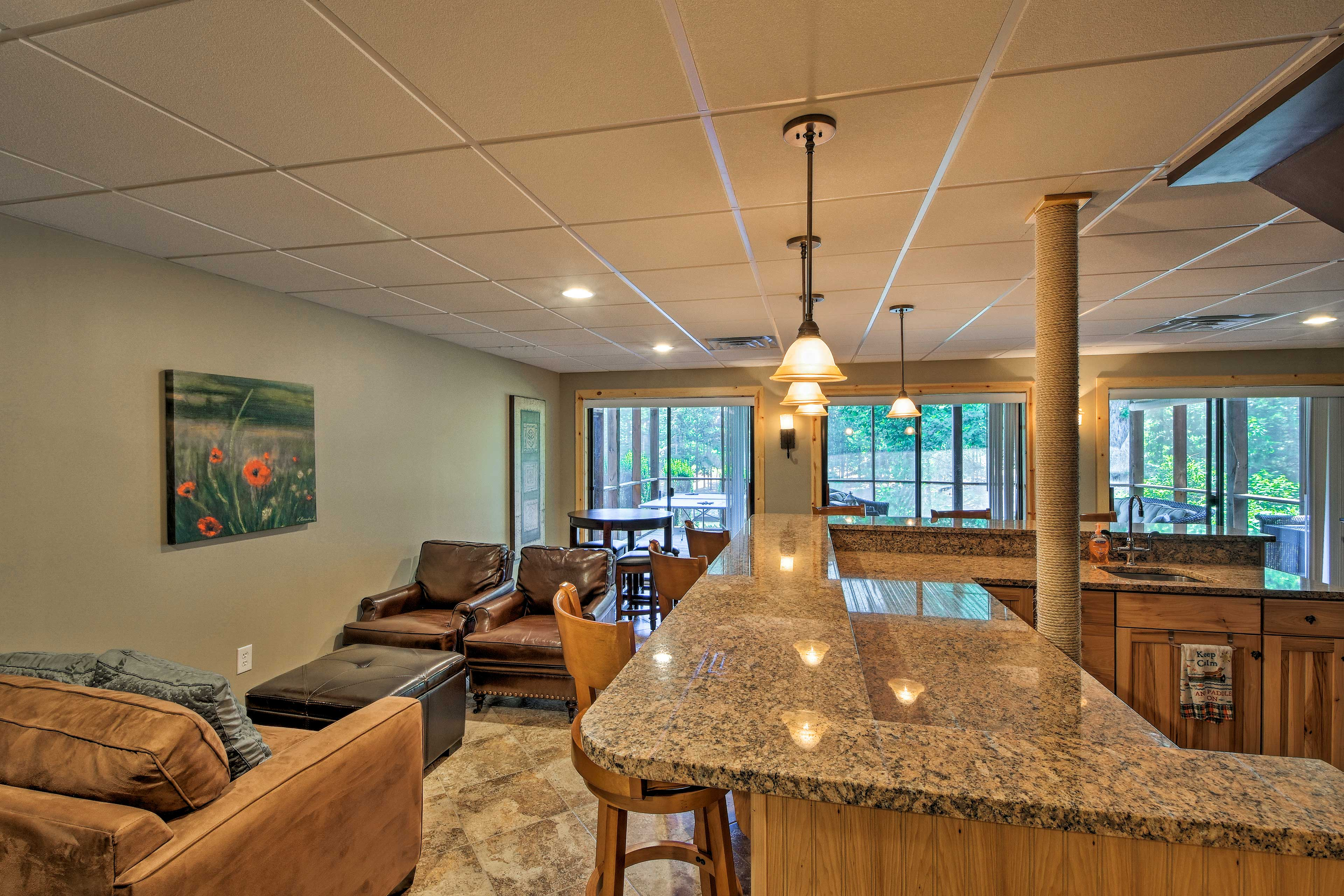 The terrace level offers a custom bar - perfect for entertaining.