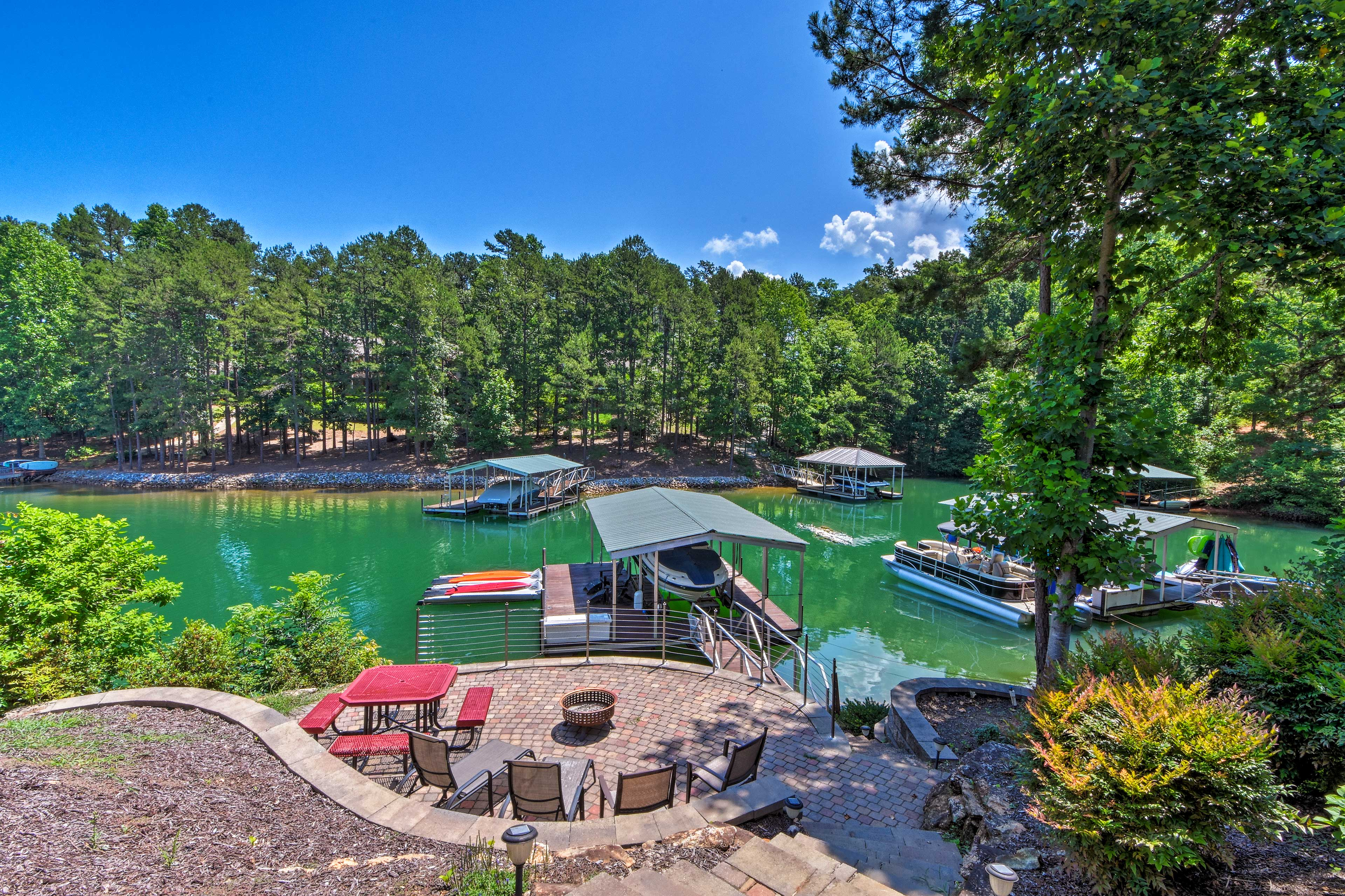 You'll be spoiled to a dock, fire pit, patio area, and direct water access.