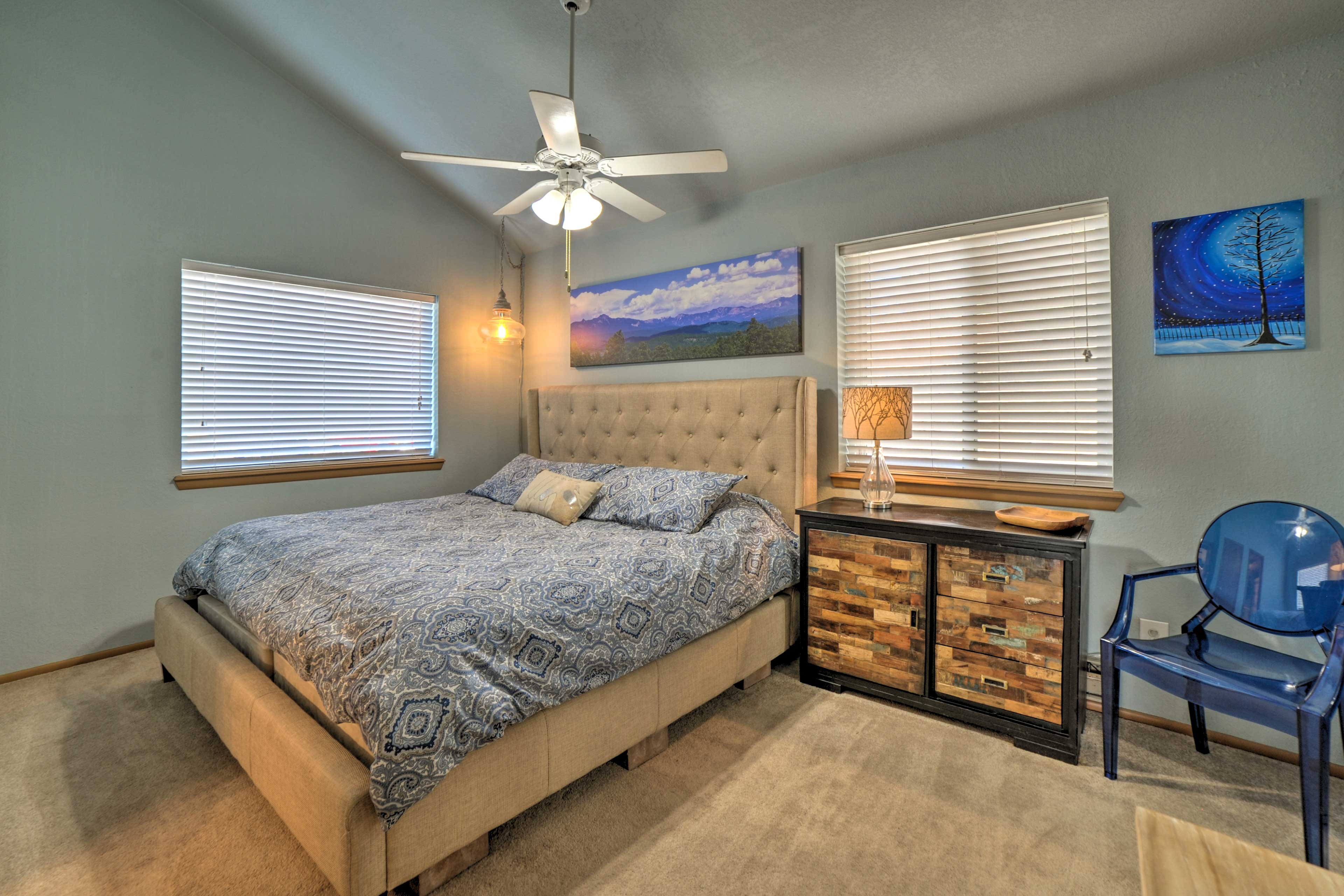 The comfortable master bedroom includes a king-sized bed.