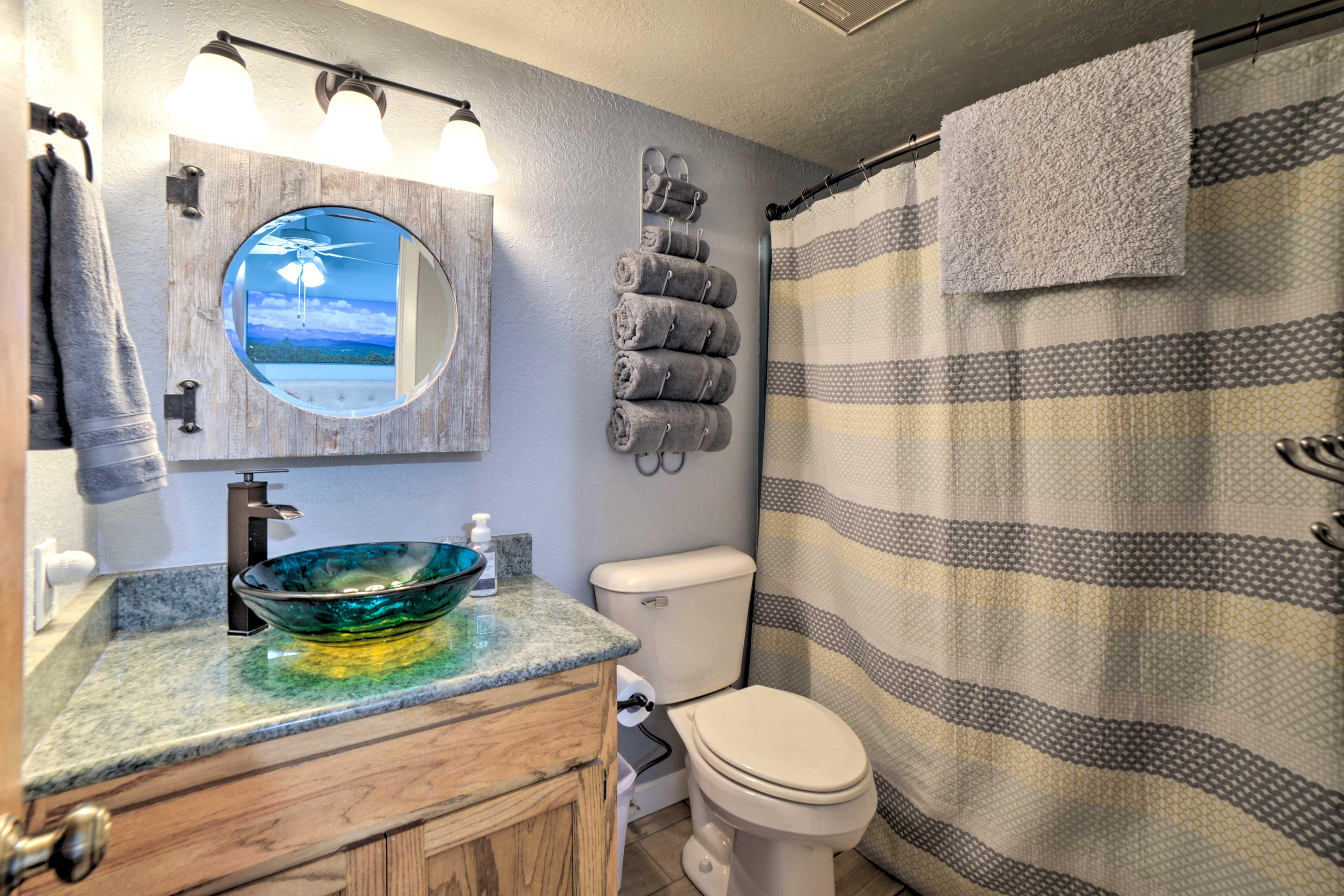 The en-suite bathroom has a shower/tub combo.