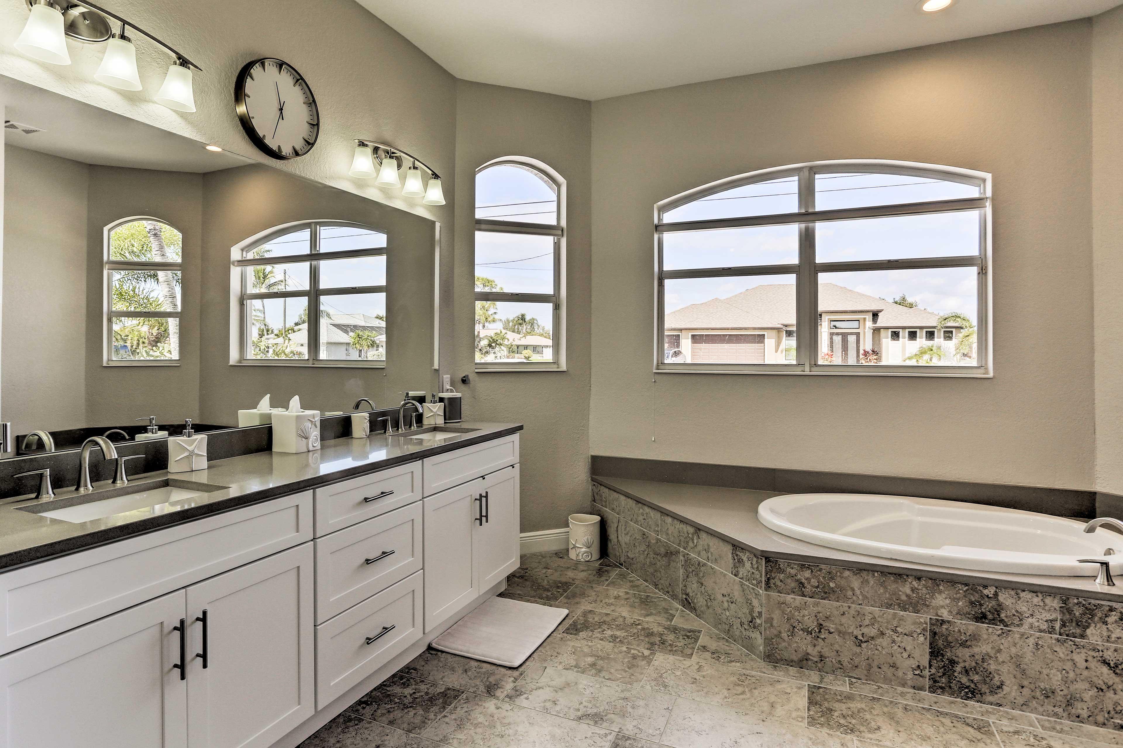 Freshen up in this spa-like en-suite bathroom.