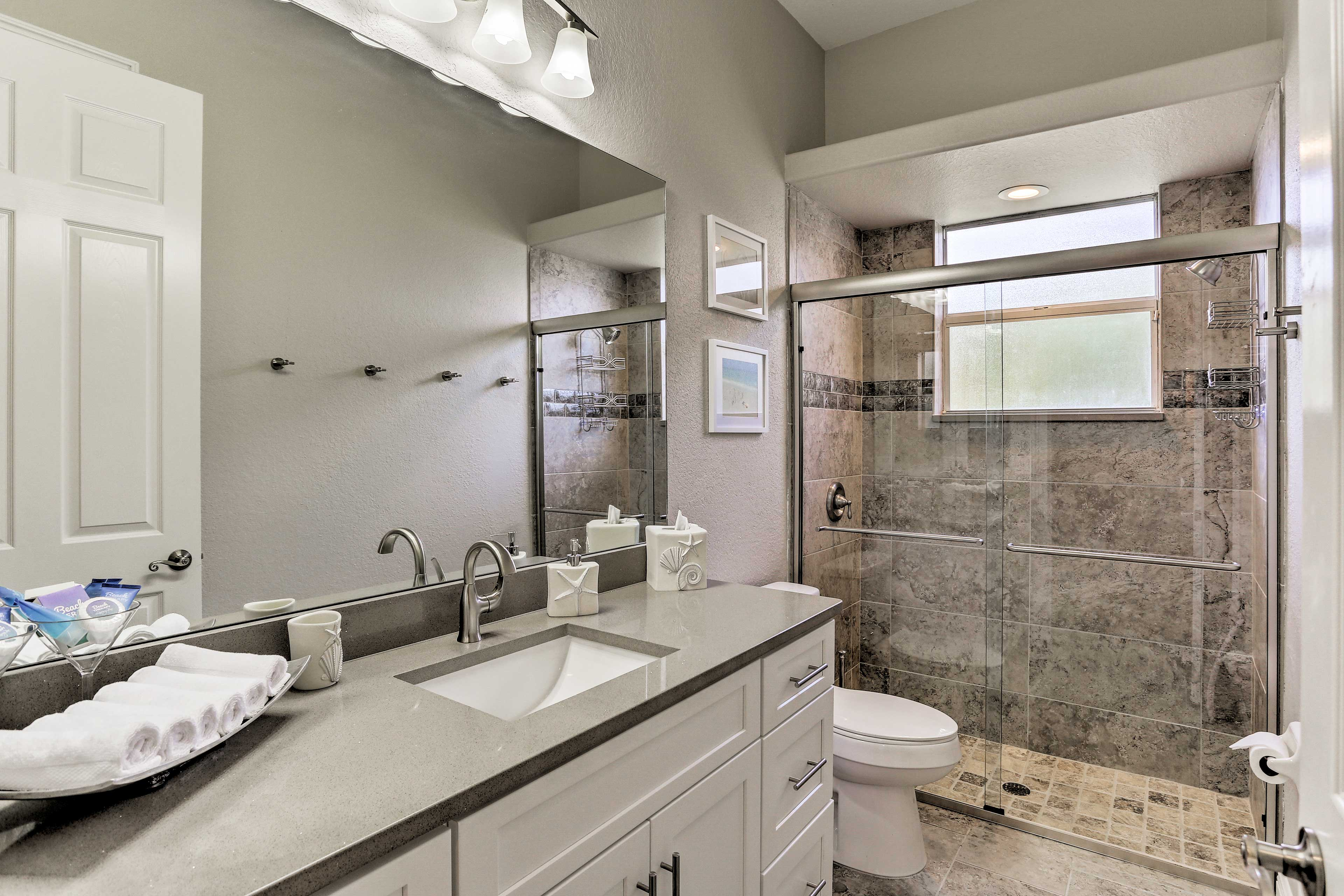 This second full bath houses a large walk-in shower.