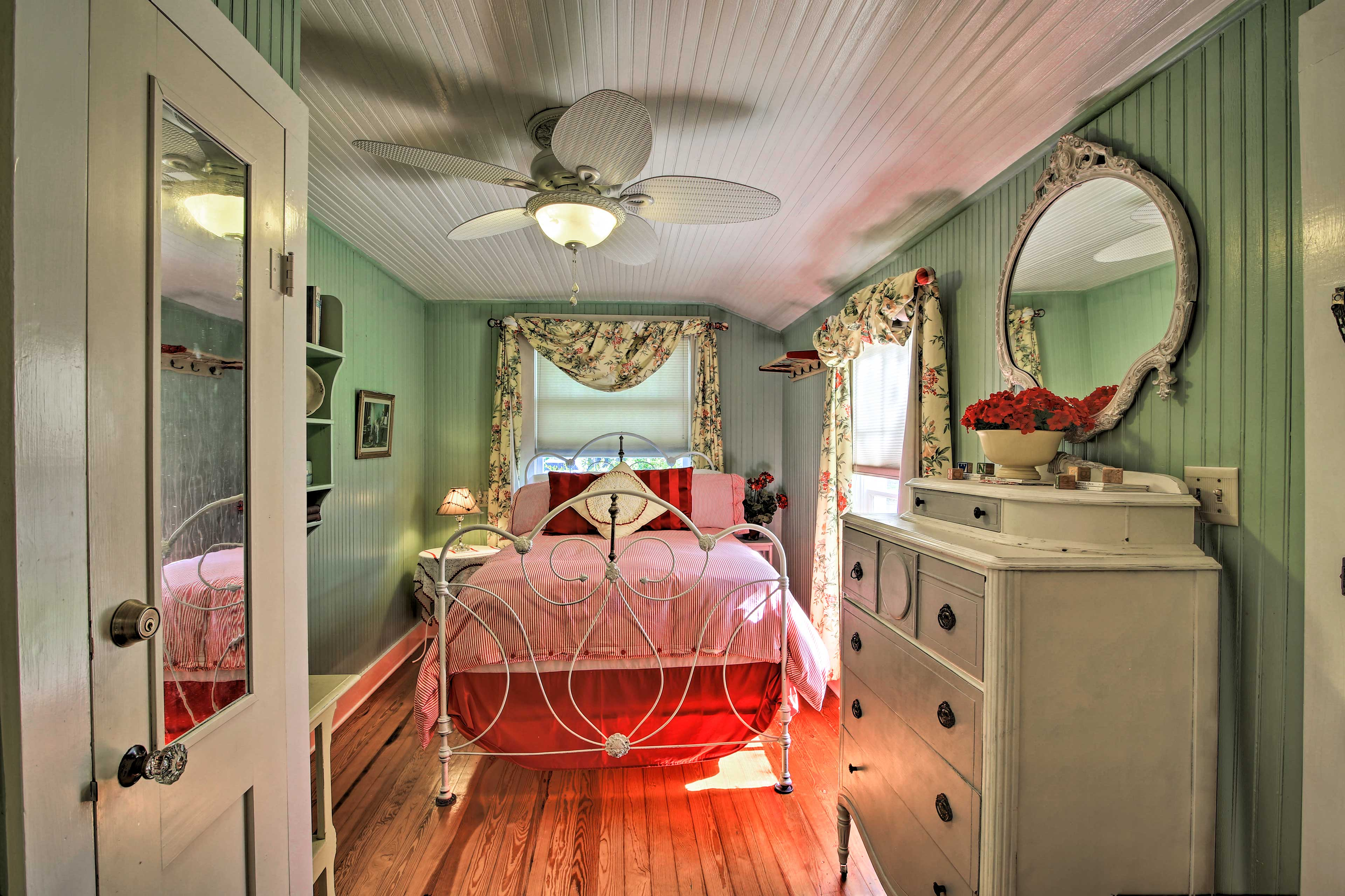 This bedroom includes a full-sized bed.