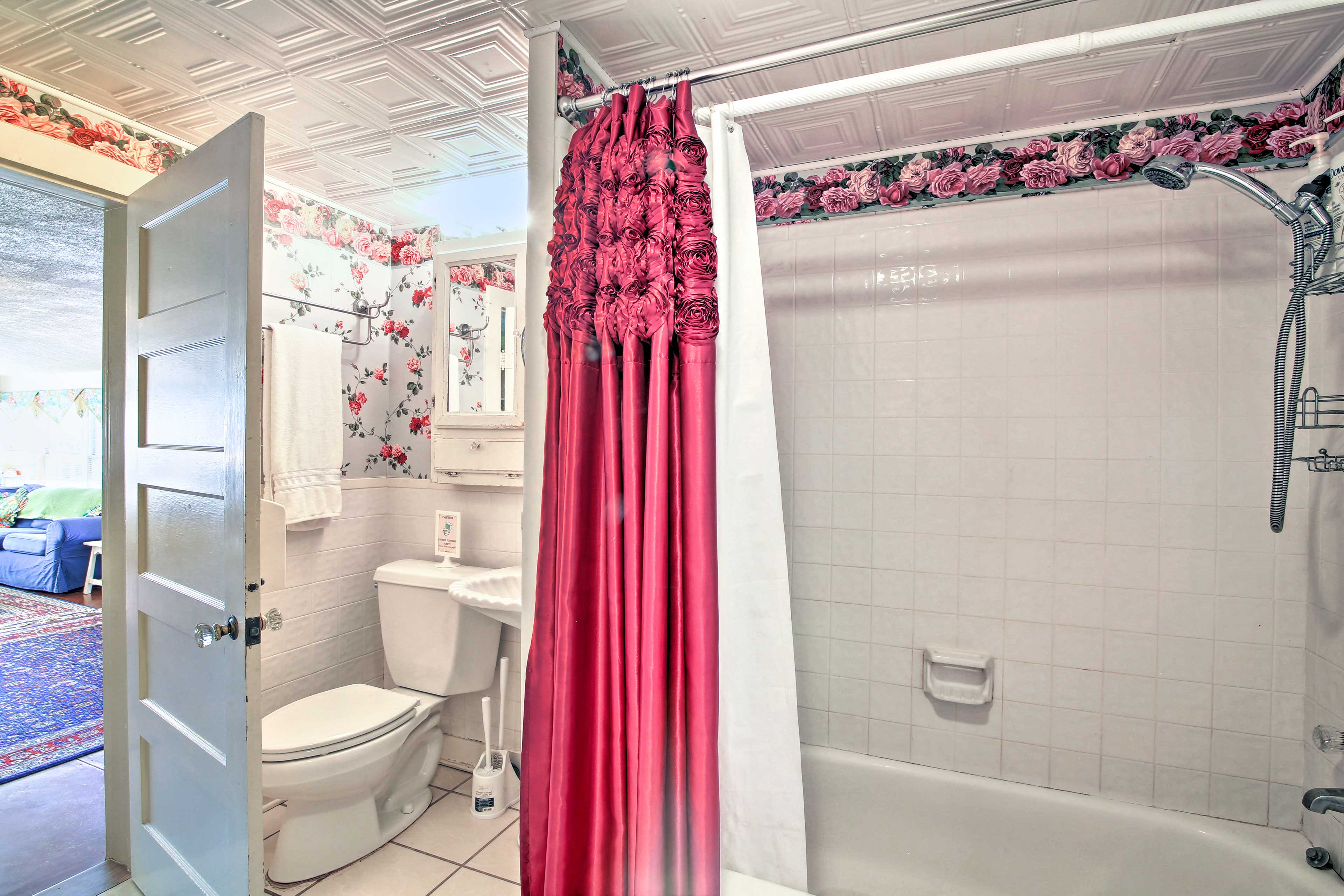 The bathroom includes a shower/tub combo.