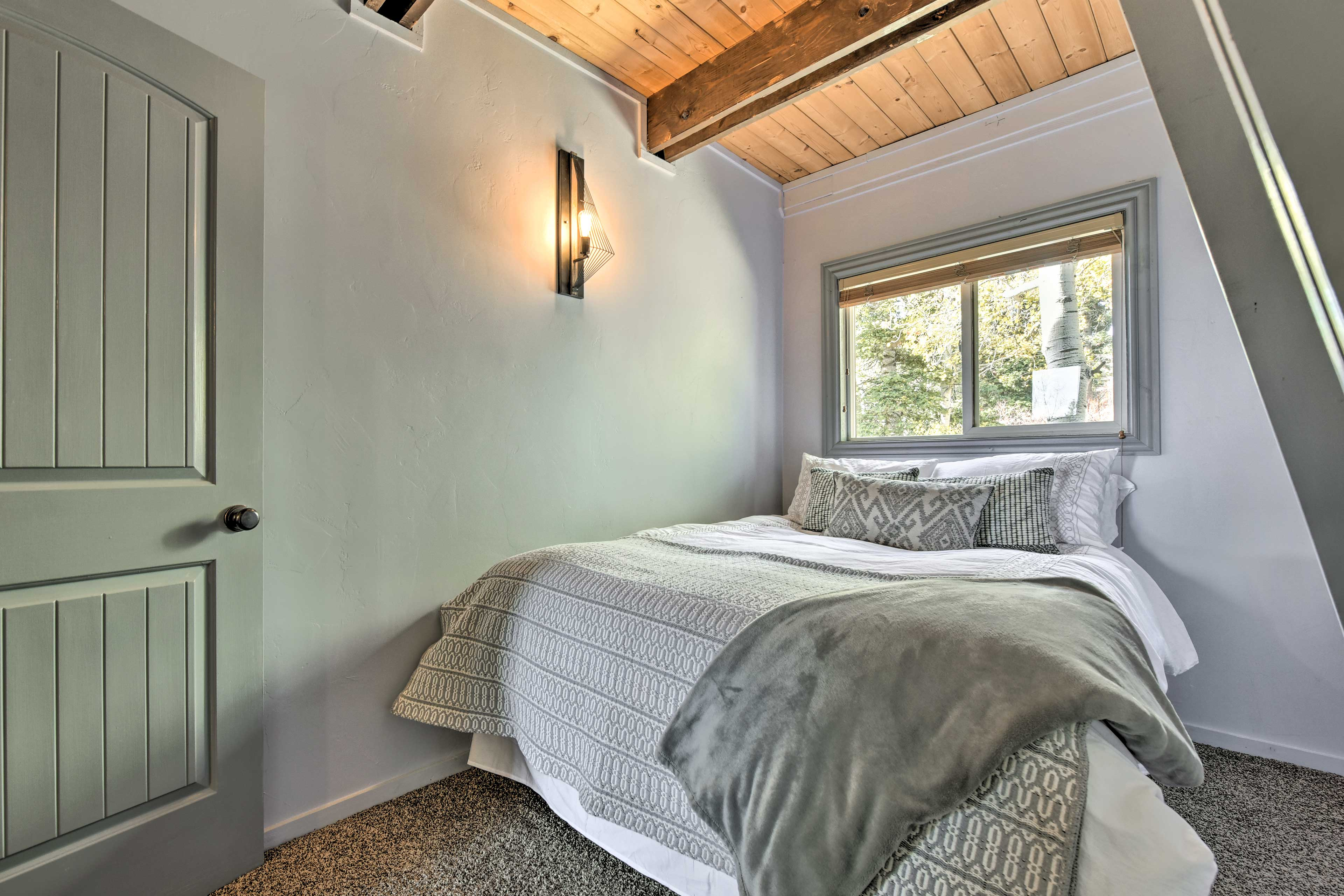 This second bedroom also houses a queen-sized bed.