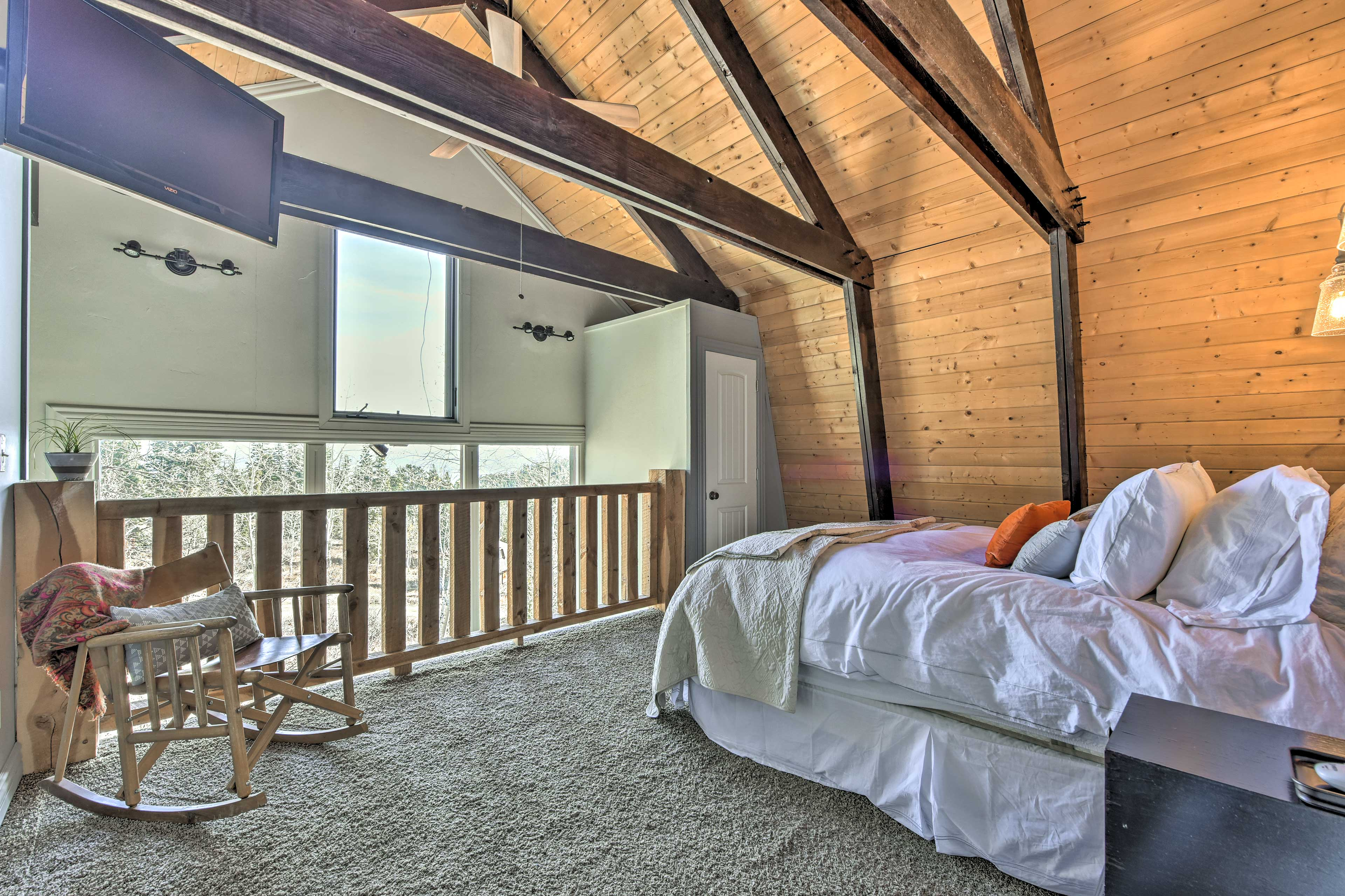 The lofted master bedroom includes a queen bed and cable TV.