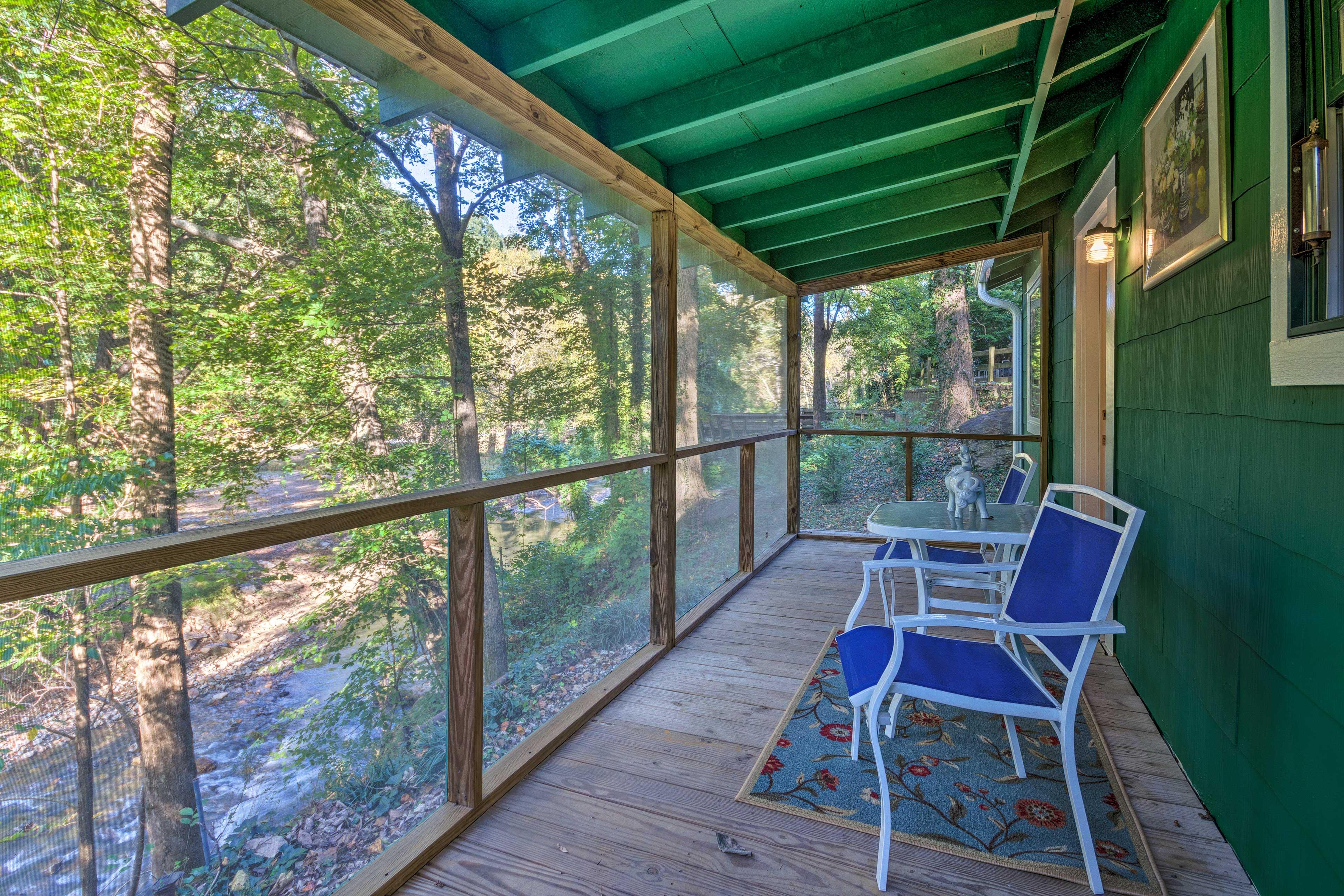 Sip morning coffee or evening nightcaps on the screened porch.