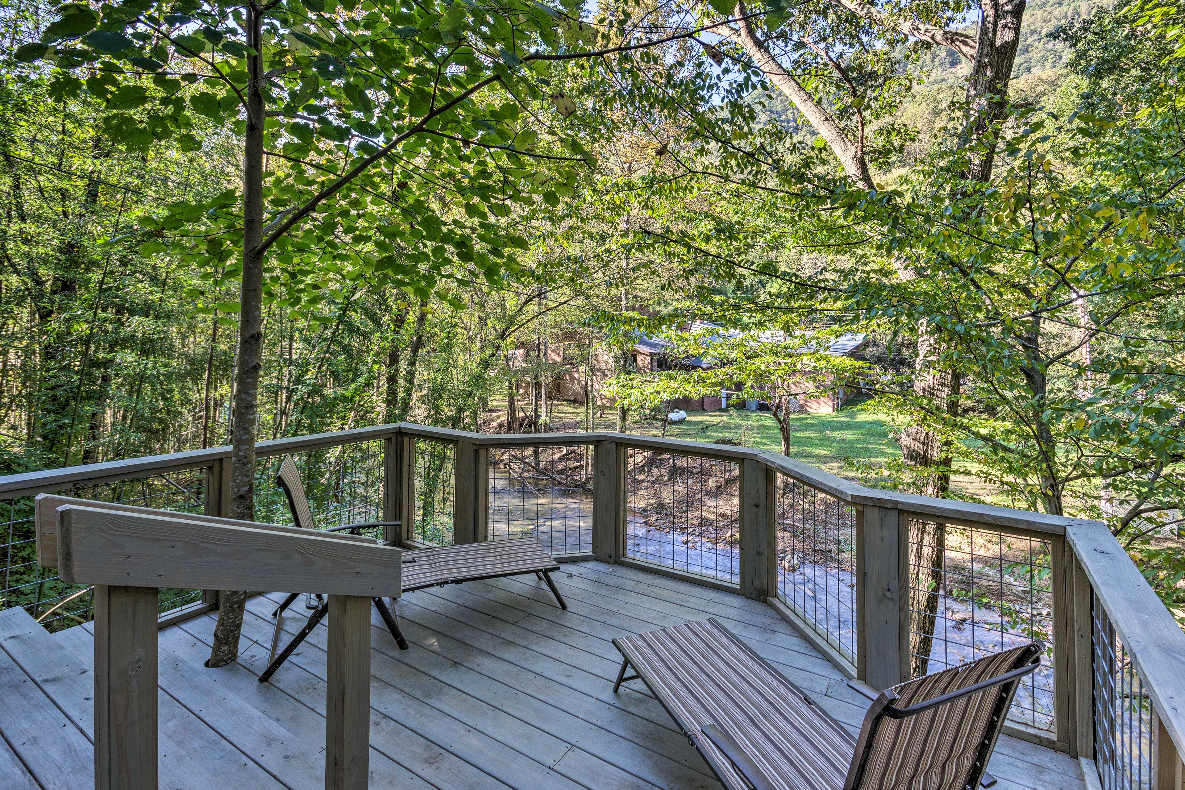 This cozy bungalow sits right on the edge of bubbling Pacolet River.