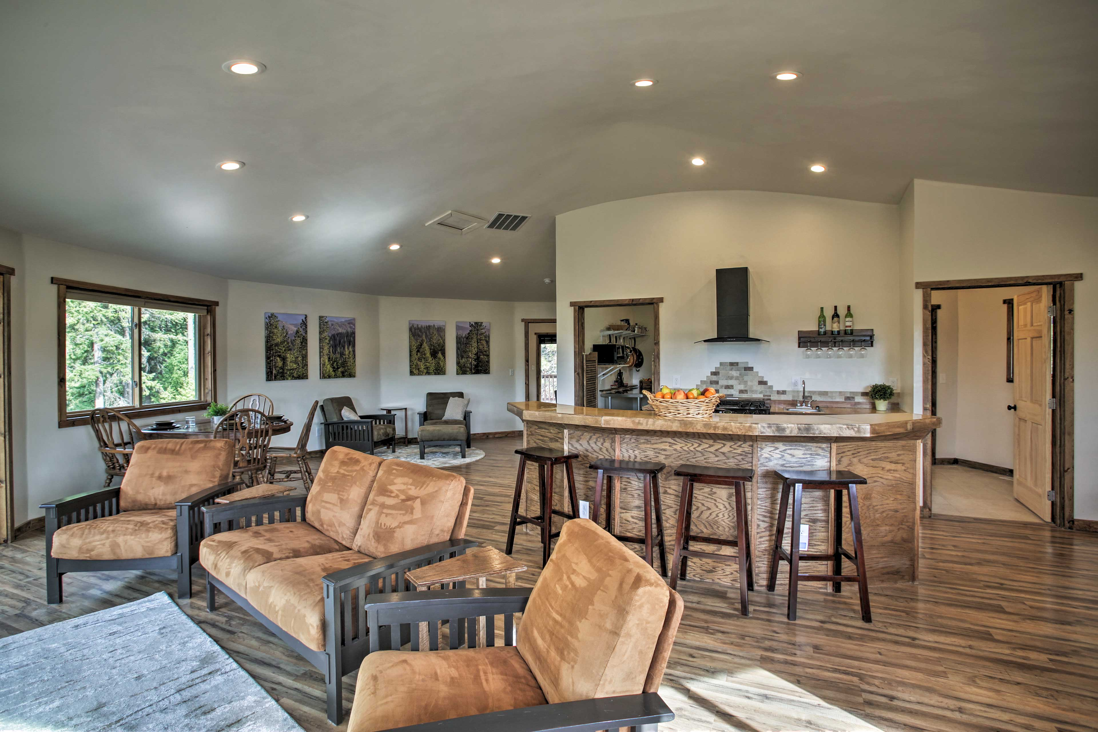 Sleek hardwood floors fill the interior.