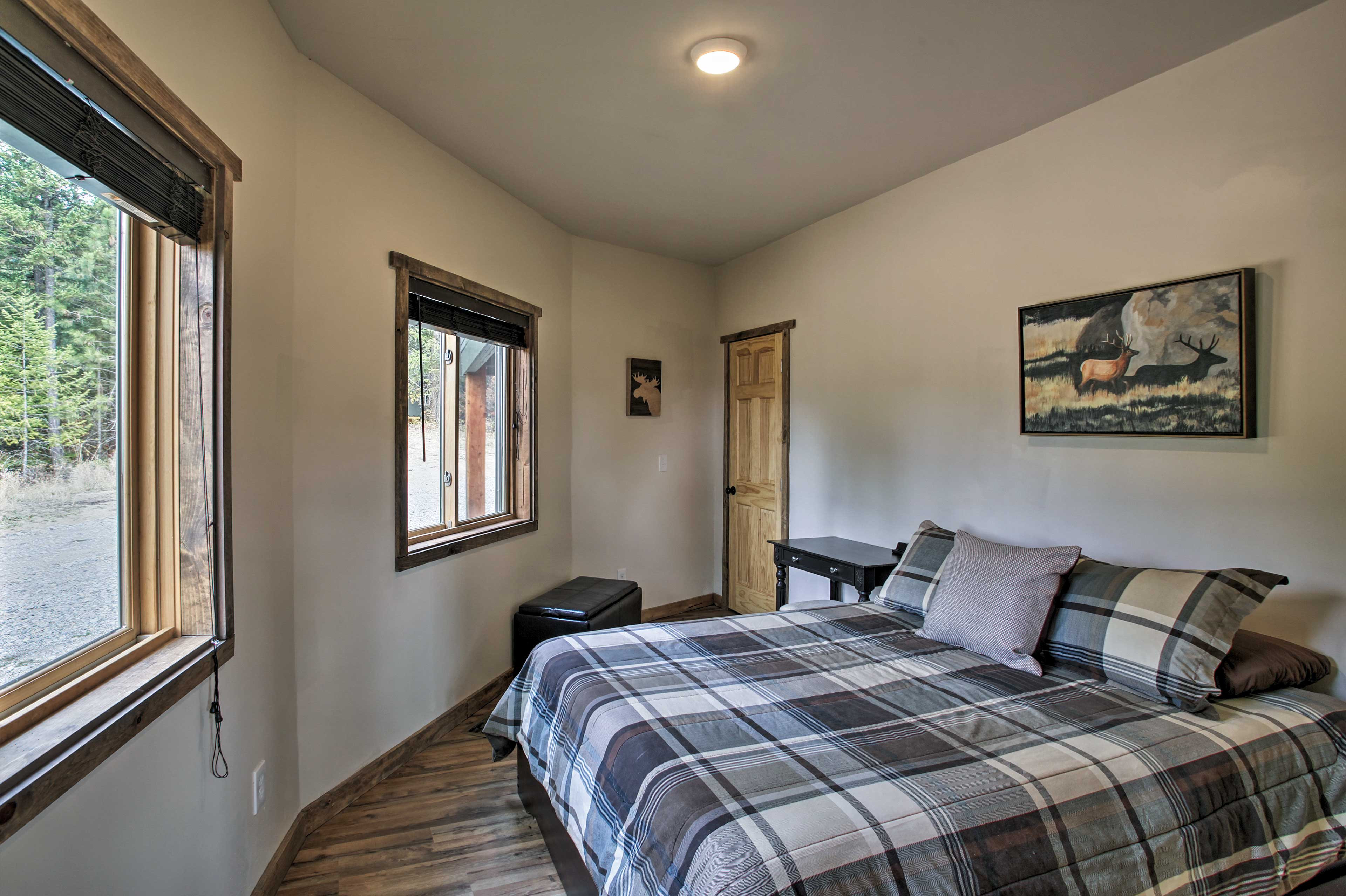Guests are sure to sleep soundly in the second bedroom.