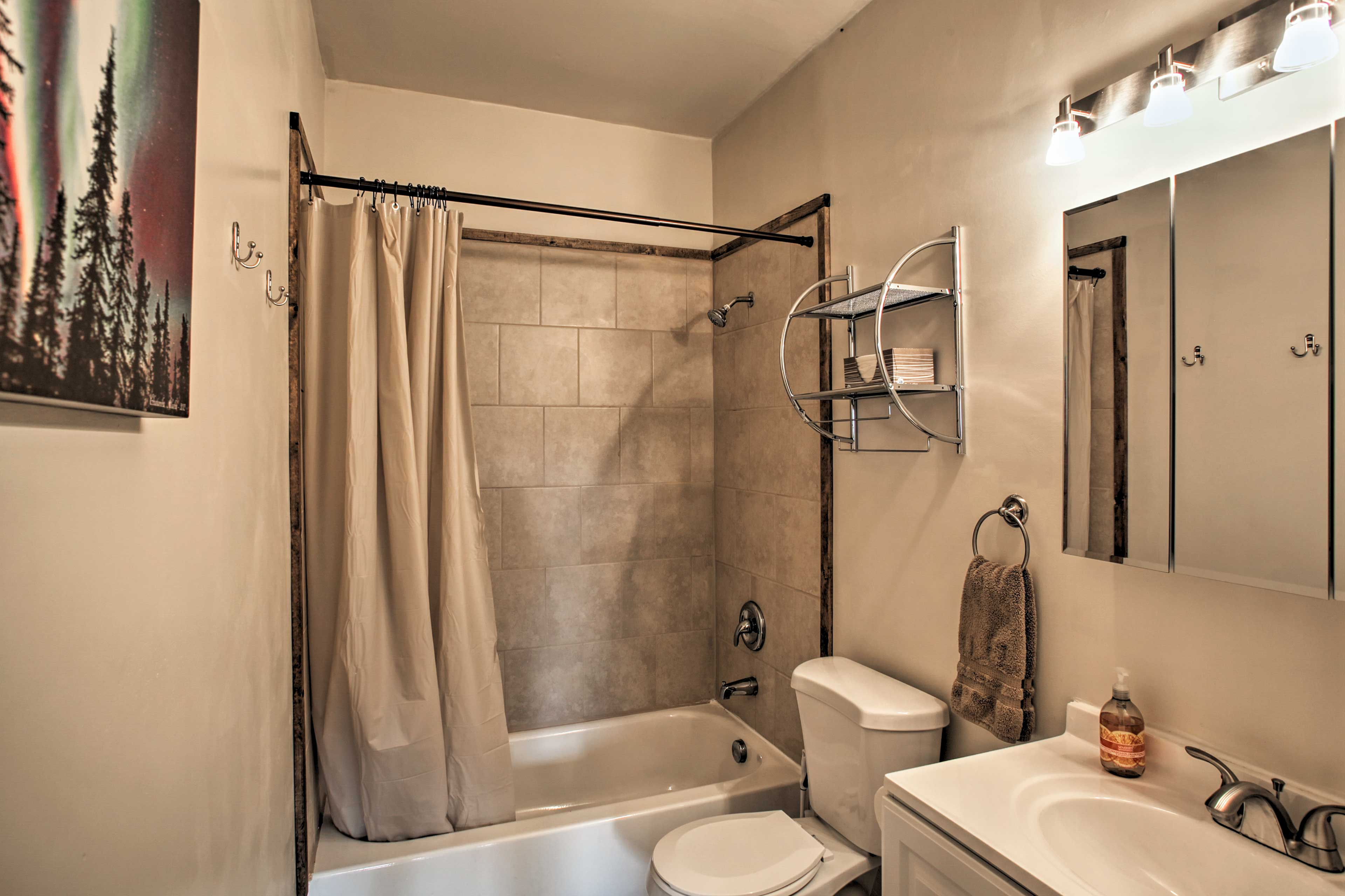 Each bathroom is stocked with towels.