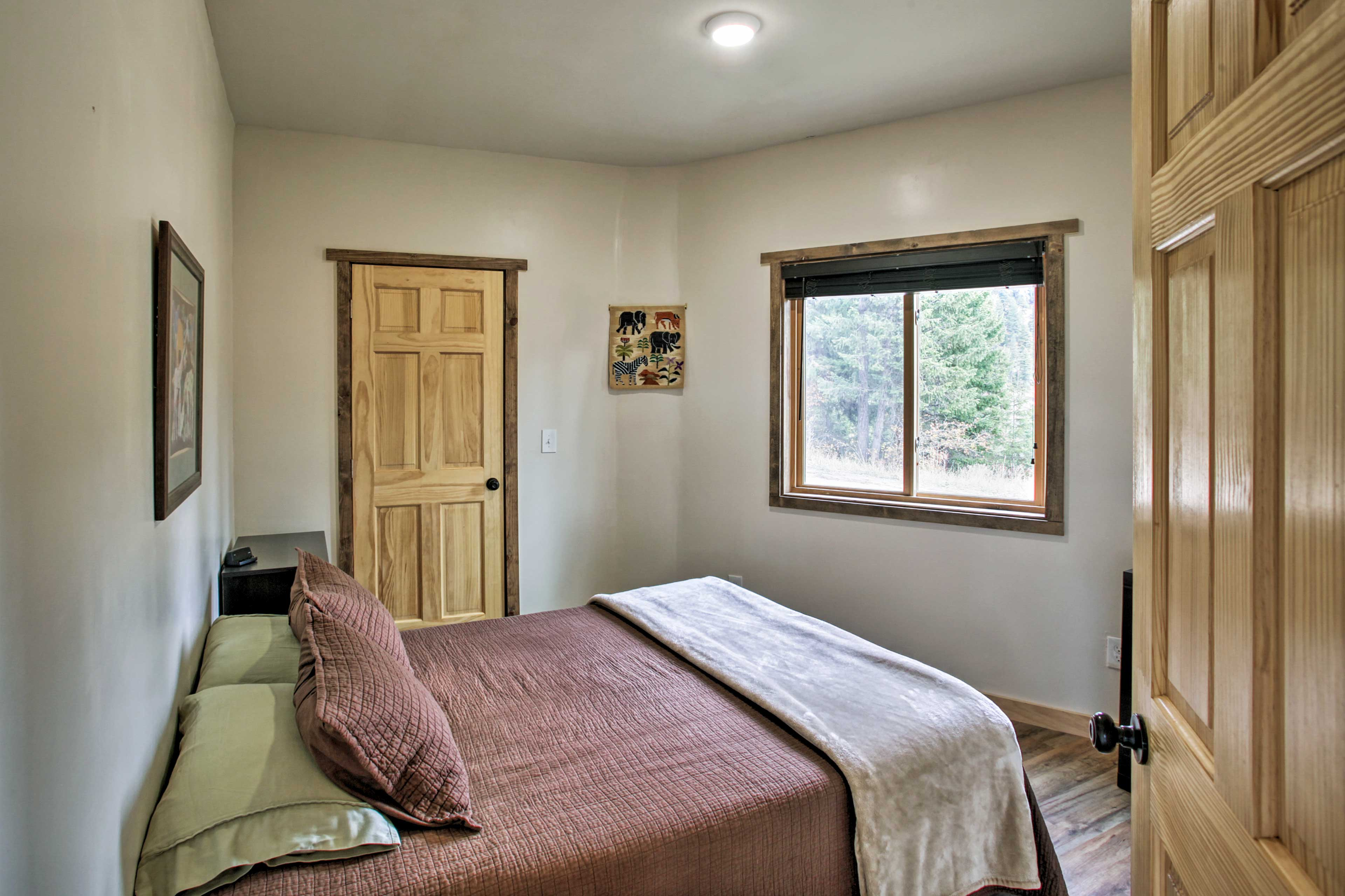 The third bedroom is outfitted with a queen bed.