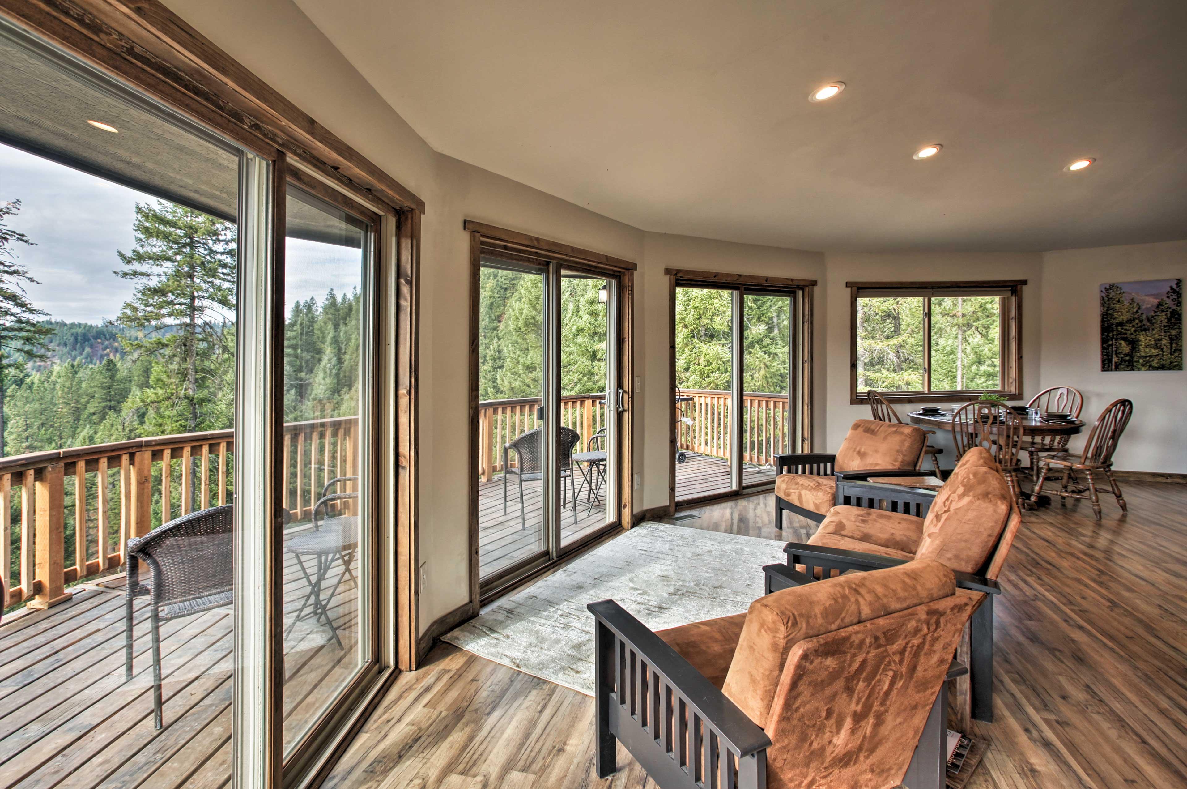 Enjoy amazing wooded views through the 3 sliding glass doors!