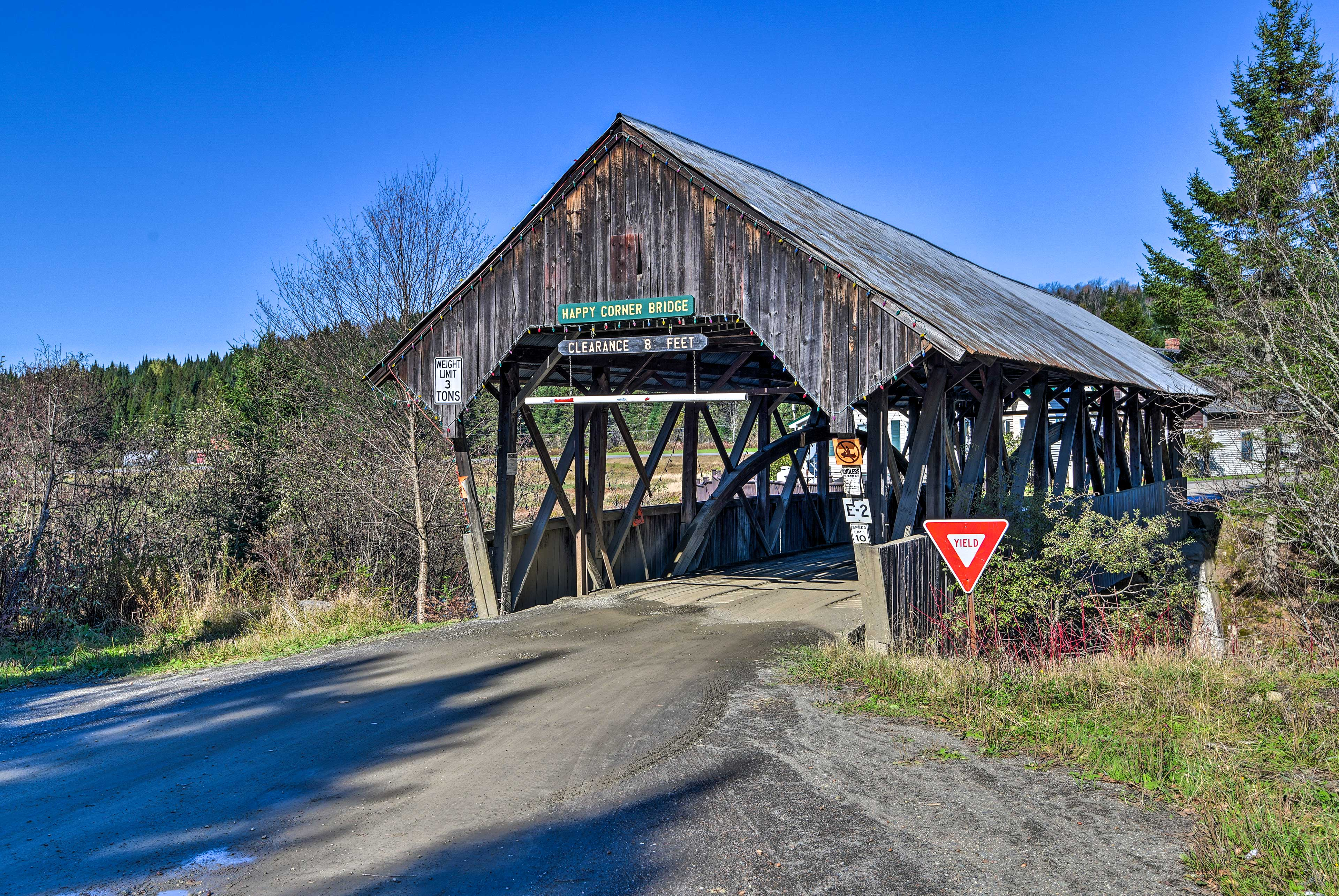 This covered wooden bridge sits just steps from the property.